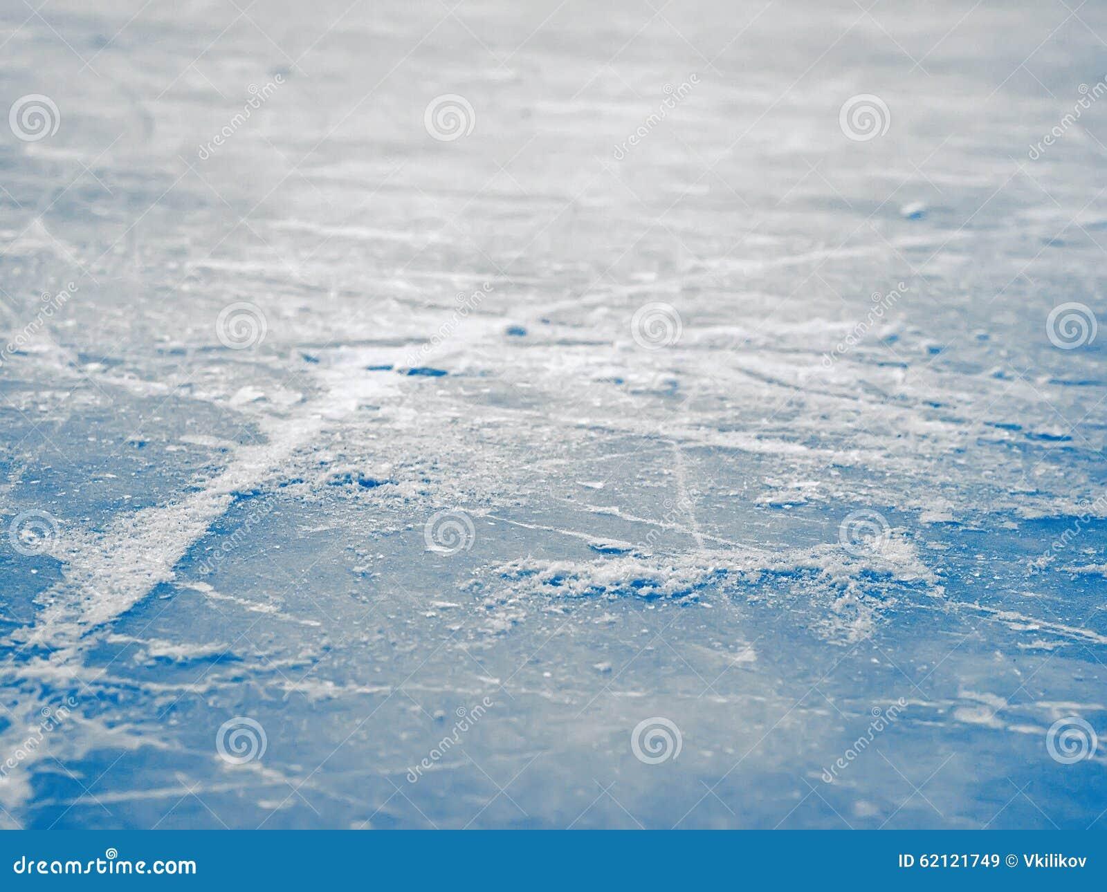 De de oppervlakteachtergrond van de ijshockeypiste, vat blauw selectief ijs samen,