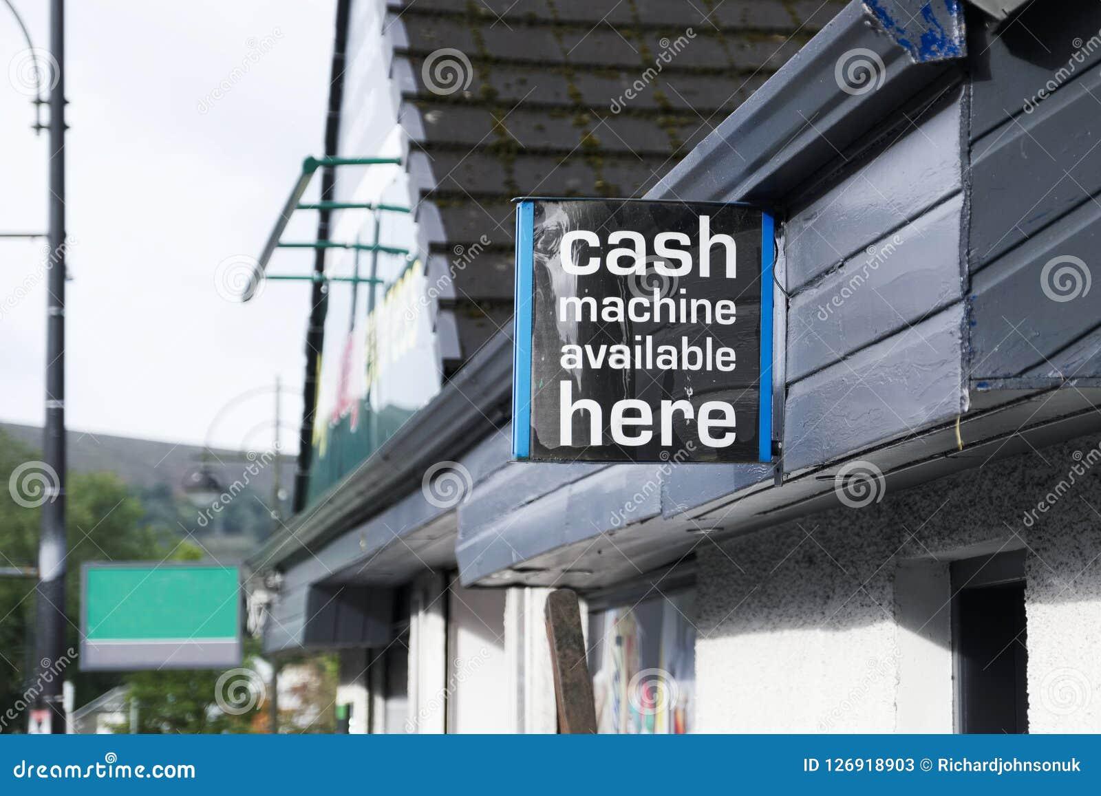 De distributeur automatique de billets la machine gratuite de retraits ici se connectent le mur