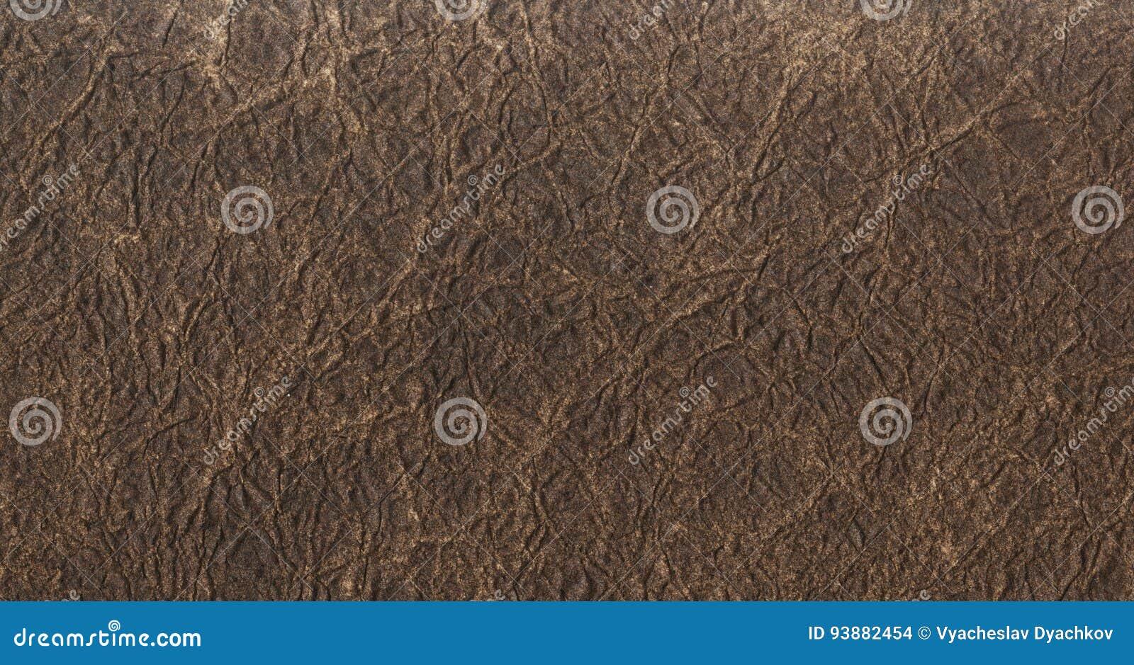 De donkere bruine achtergrond van de leertextuur Sluit omhoog van een oude leertextuur van de leertextuur bruin patroon als achte