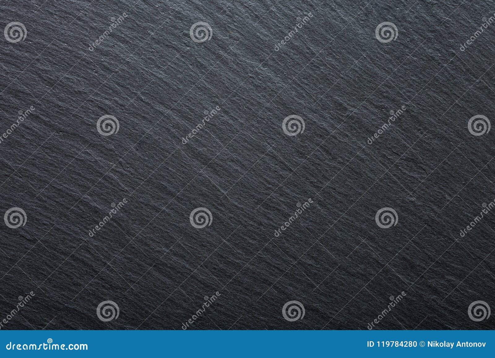 De donkere grijze en zwarte achtergrond van het leigraniet Textuurachtergrond voor uw project
