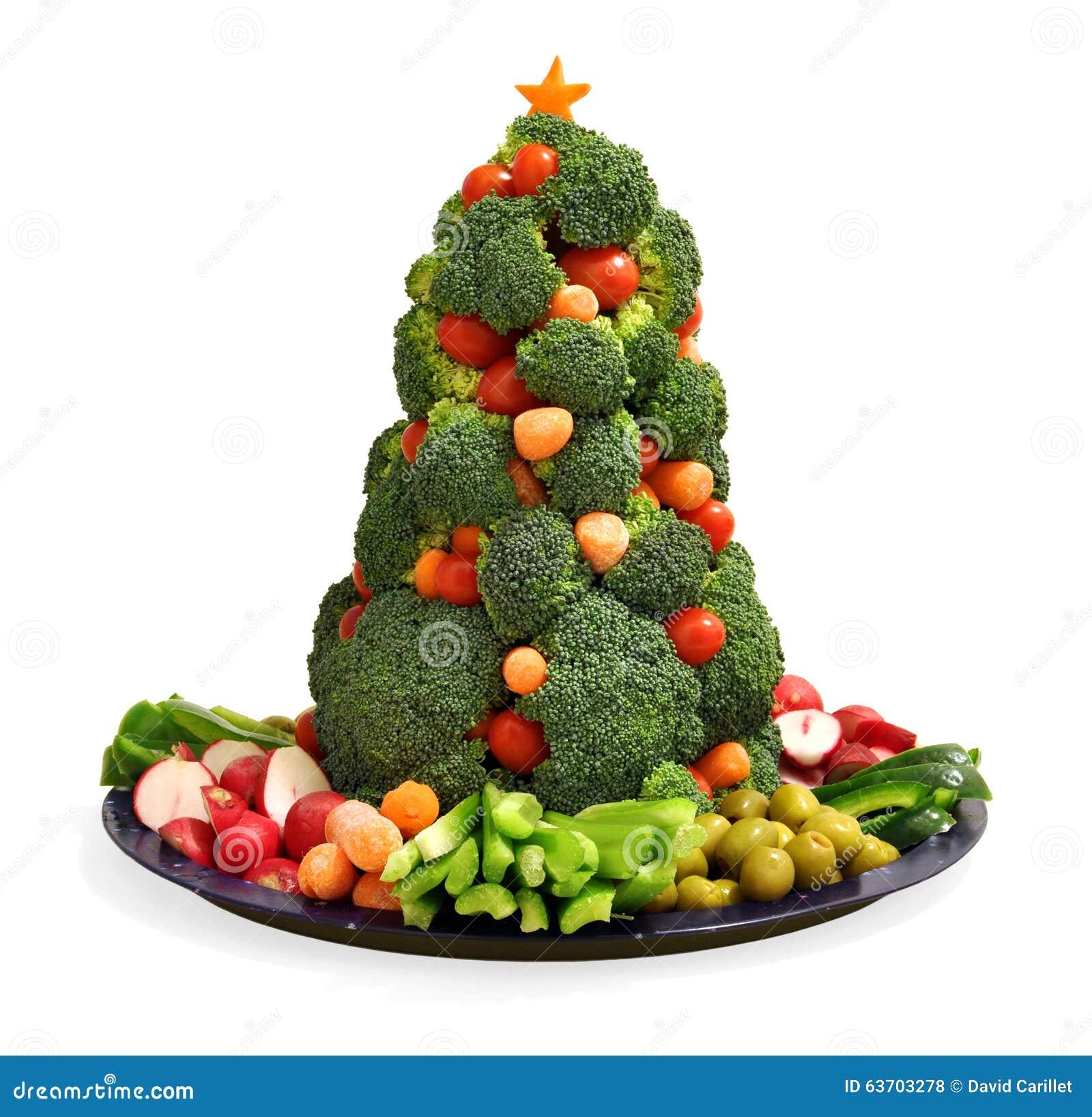 De eigengemaakte plantaardige schotel van de veganistvakantie met broccolikerstboom