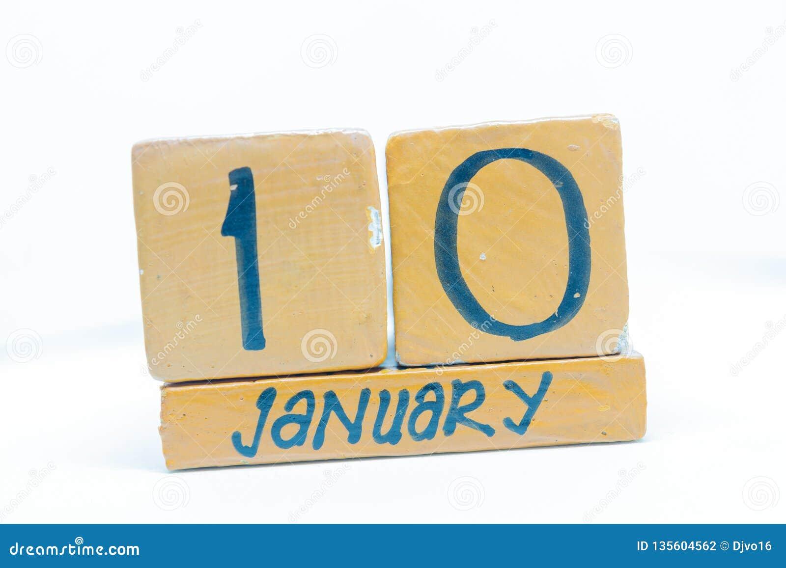 10 de enero Día 10 del mes, calendario en fondo de madera Invierno, concepto del año