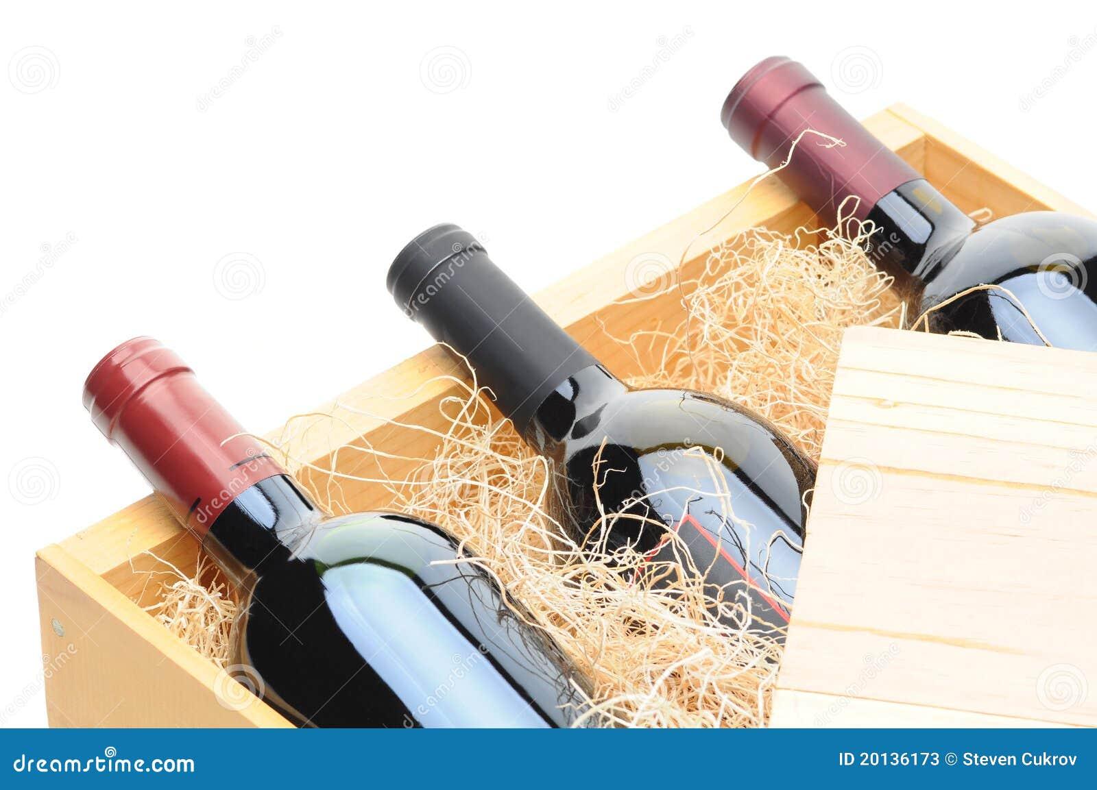 De Flessen van de wijn in houten krat