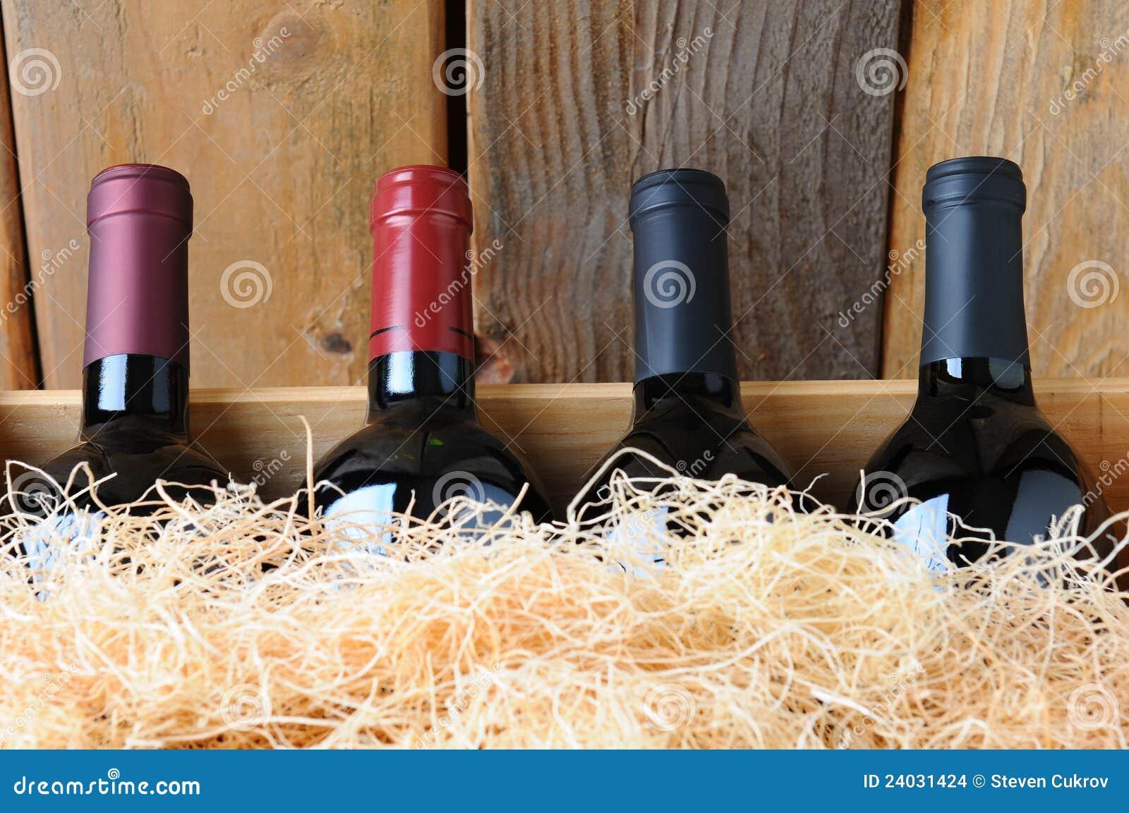De Flessen van de Wijn van de close-up in Krat