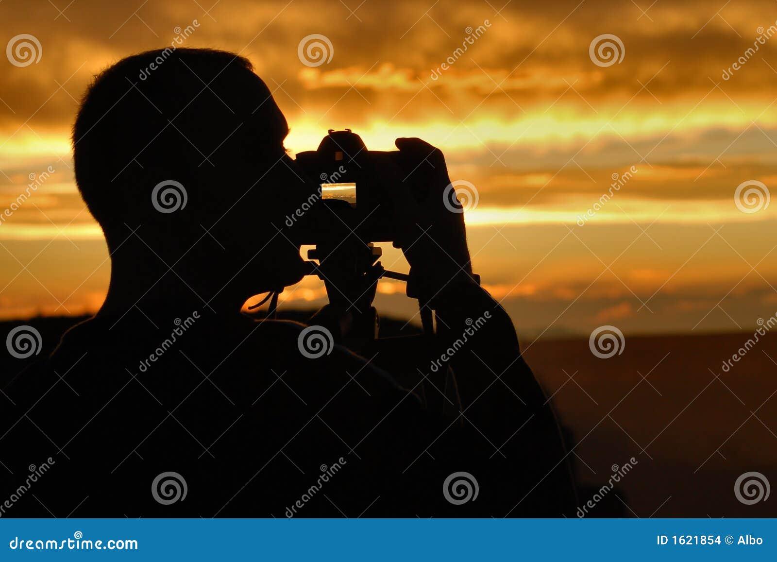 De fotograaf van de zonsondergang