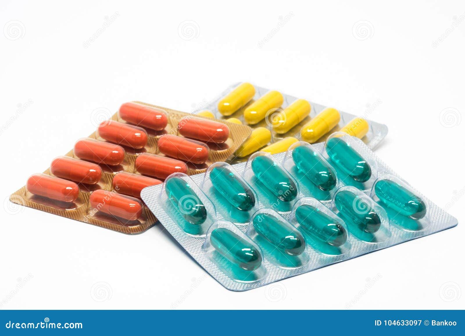 Download De Geelgroene En Oranje Pillen Van Gelatinecapsules In Blaarpak Stock Afbeelding - Afbeelding bestaande uit ziekte, naughty: 104633097