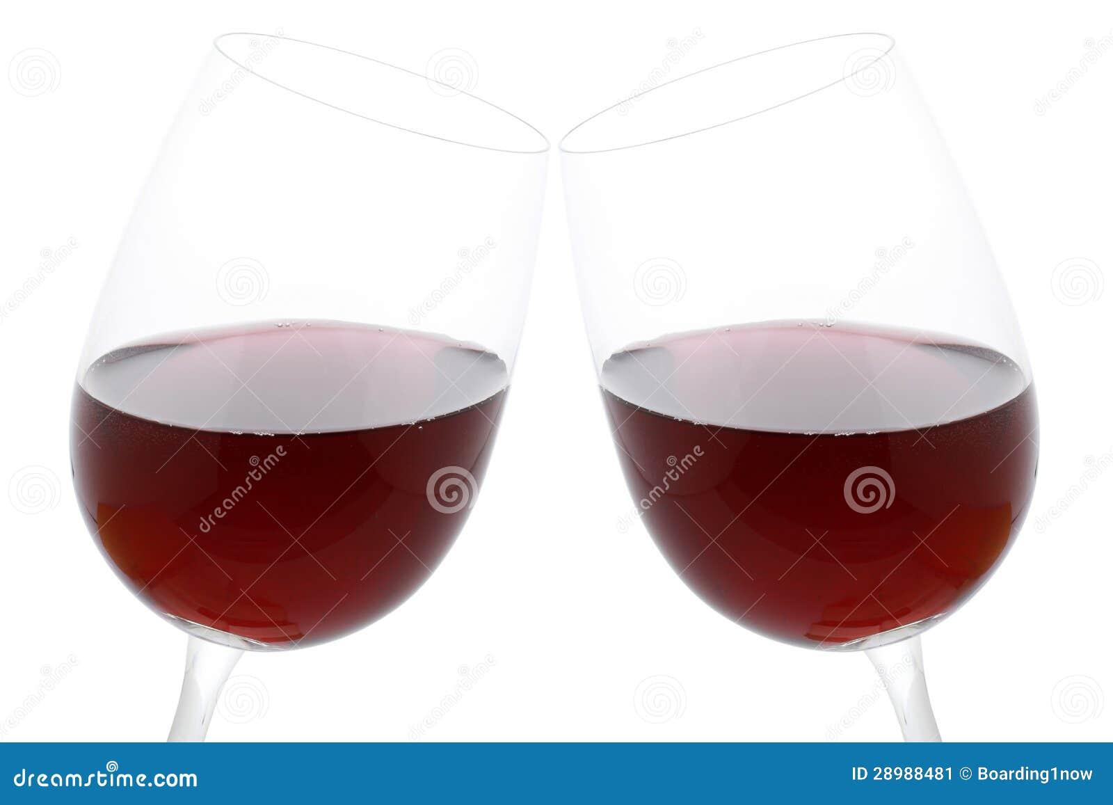 De glazen van het gerinkel met rode wijn