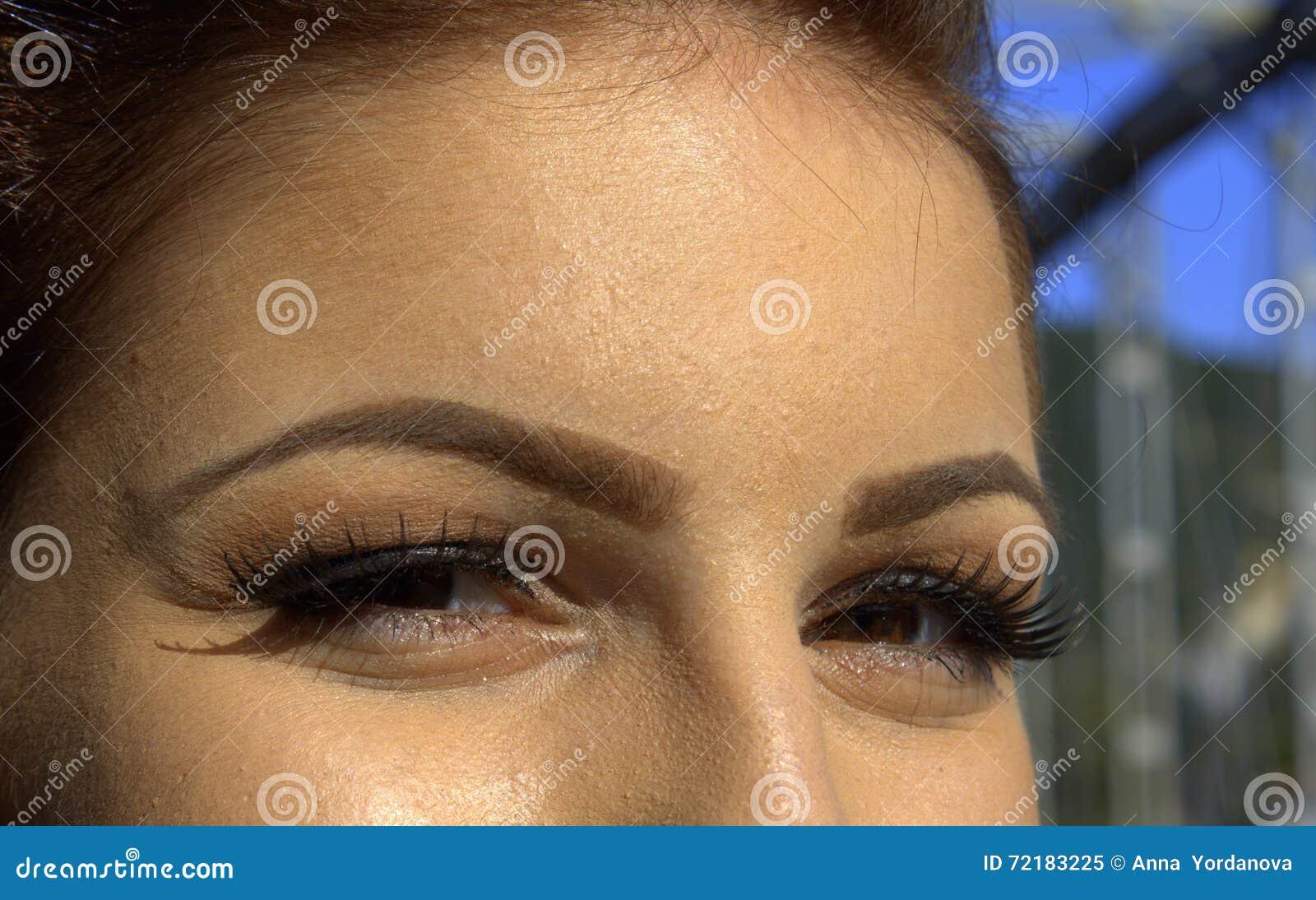 De glimlachende ogen van de schoonheidsmake-up