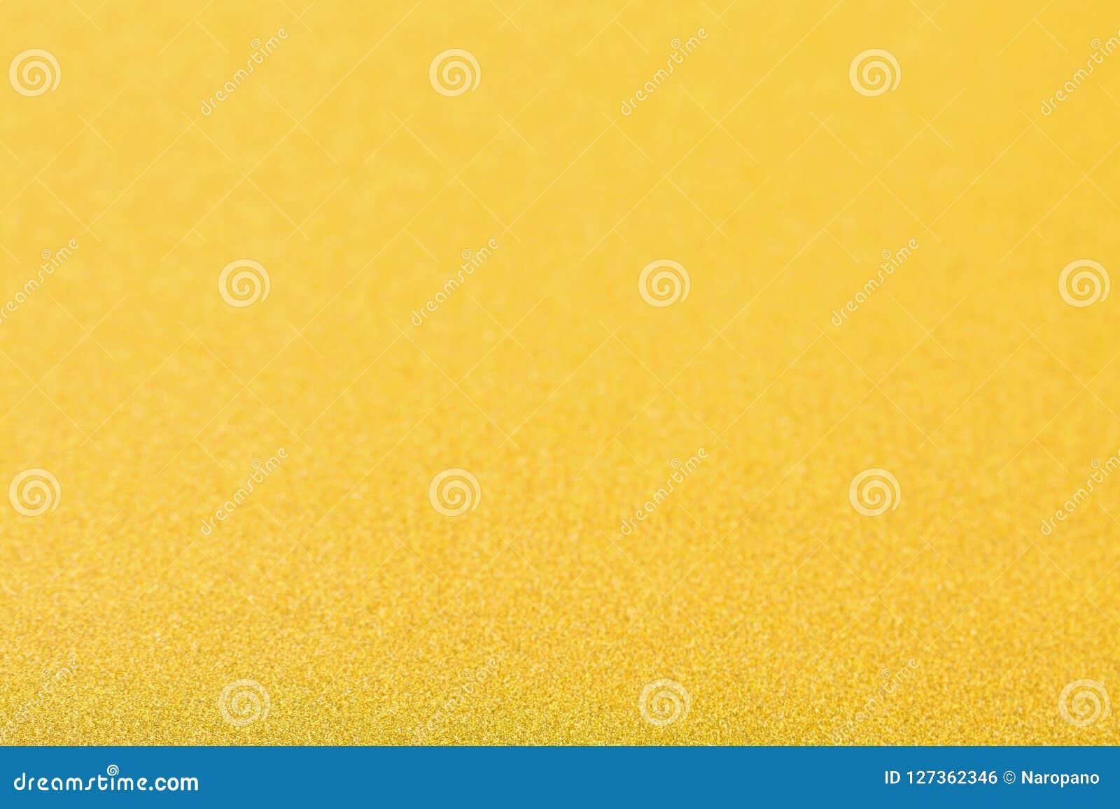 De gouden achtergrond, abstracte Kerstmis schittert bokeh spatie voor desi