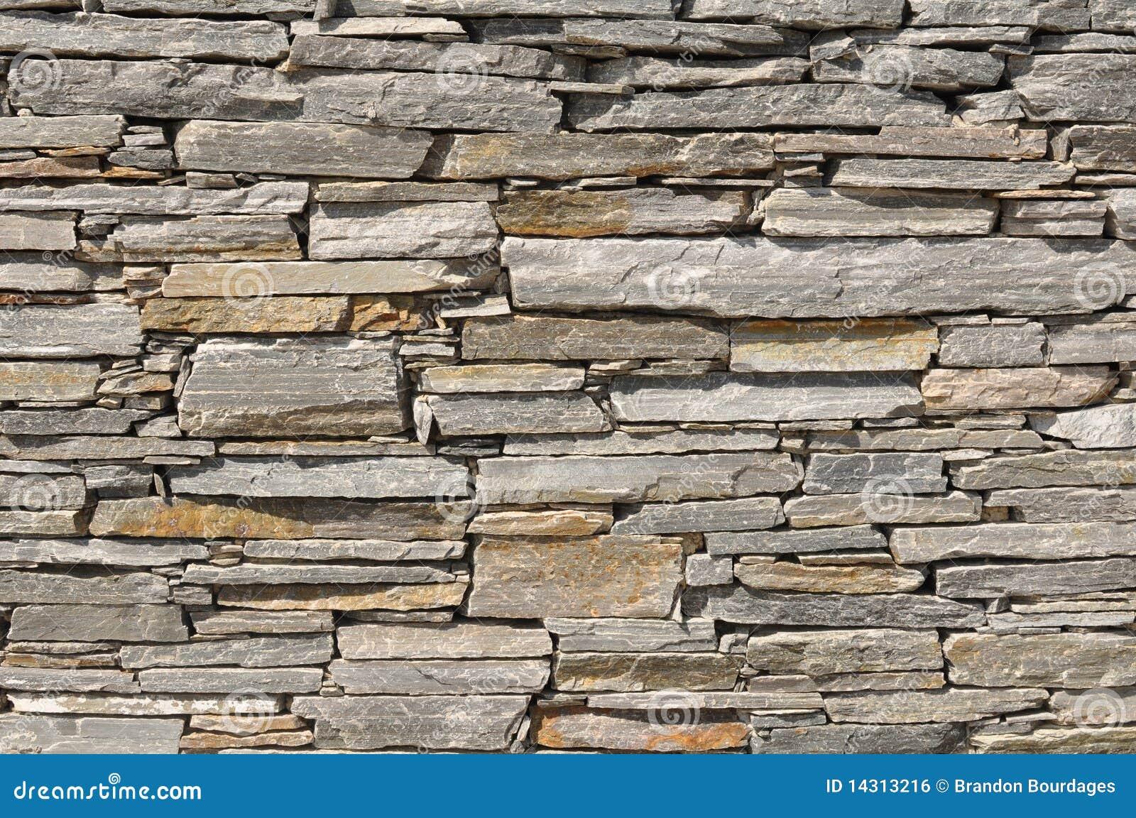 De grijze achtergrond van de bakstenen muur van de steen royalty ...
