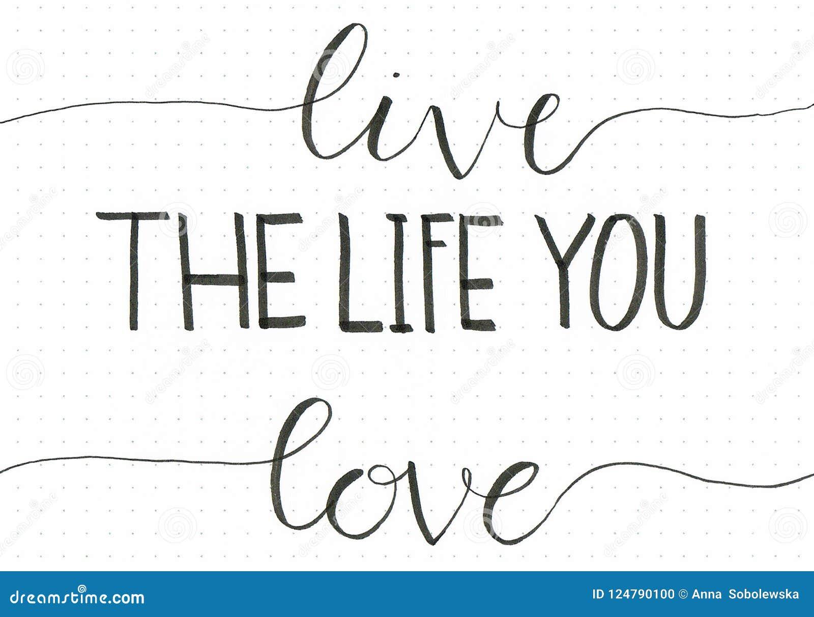 ` De hand van Live The Life You Love ` het van letters voorzien uitdrukking om mensen te motiveren om te doen van wat zij houden