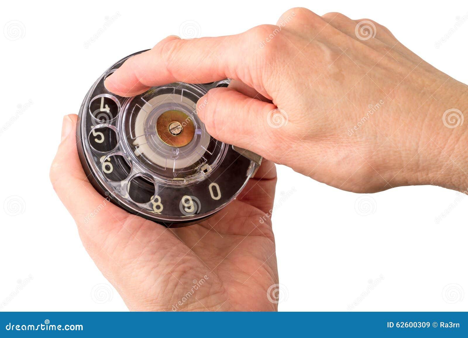 De handen van de vrouw met een dialer