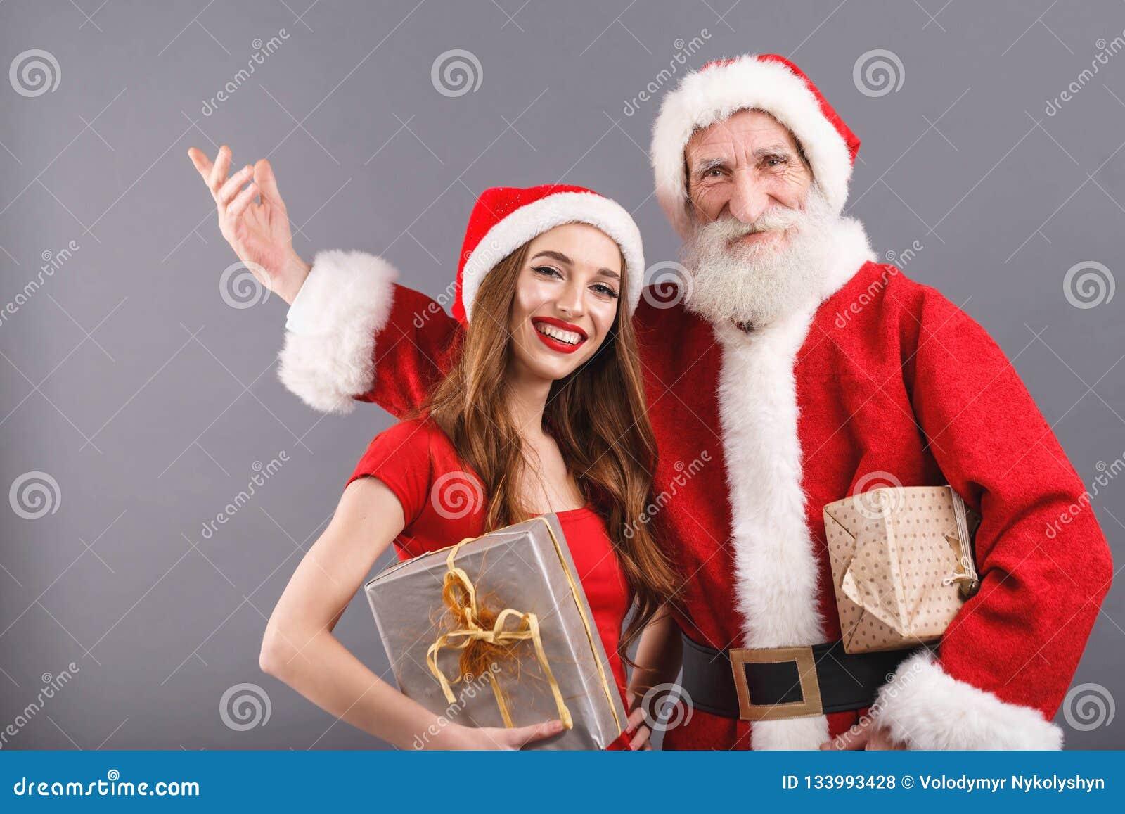 De heer en Mevr Claus Congratulates With Merry Christmass en Gelukkig Nieuwjaar