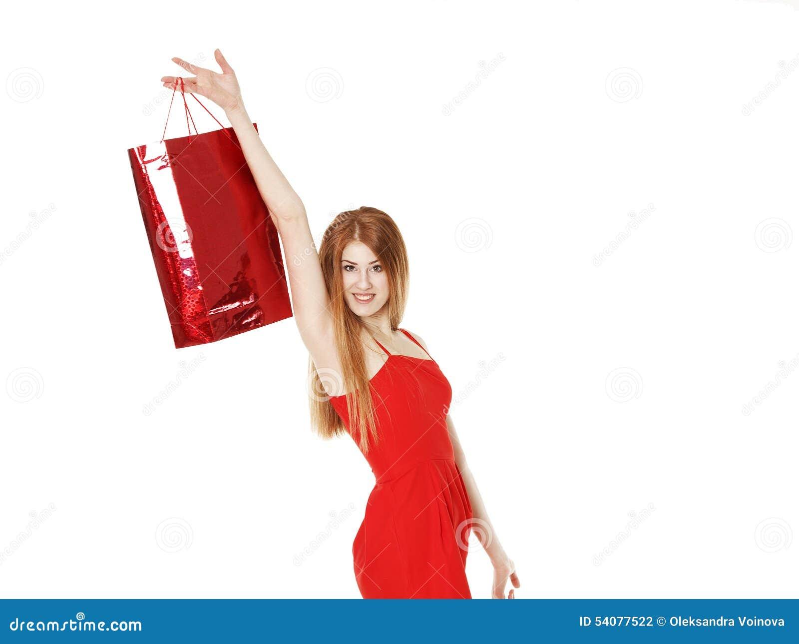 De jonge mooie vrouw maakt het winkelen