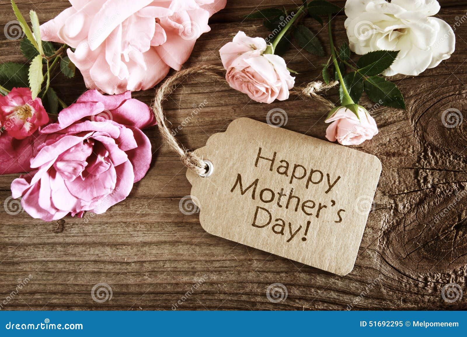 De kaart van de moedersdag met rustieke rozen