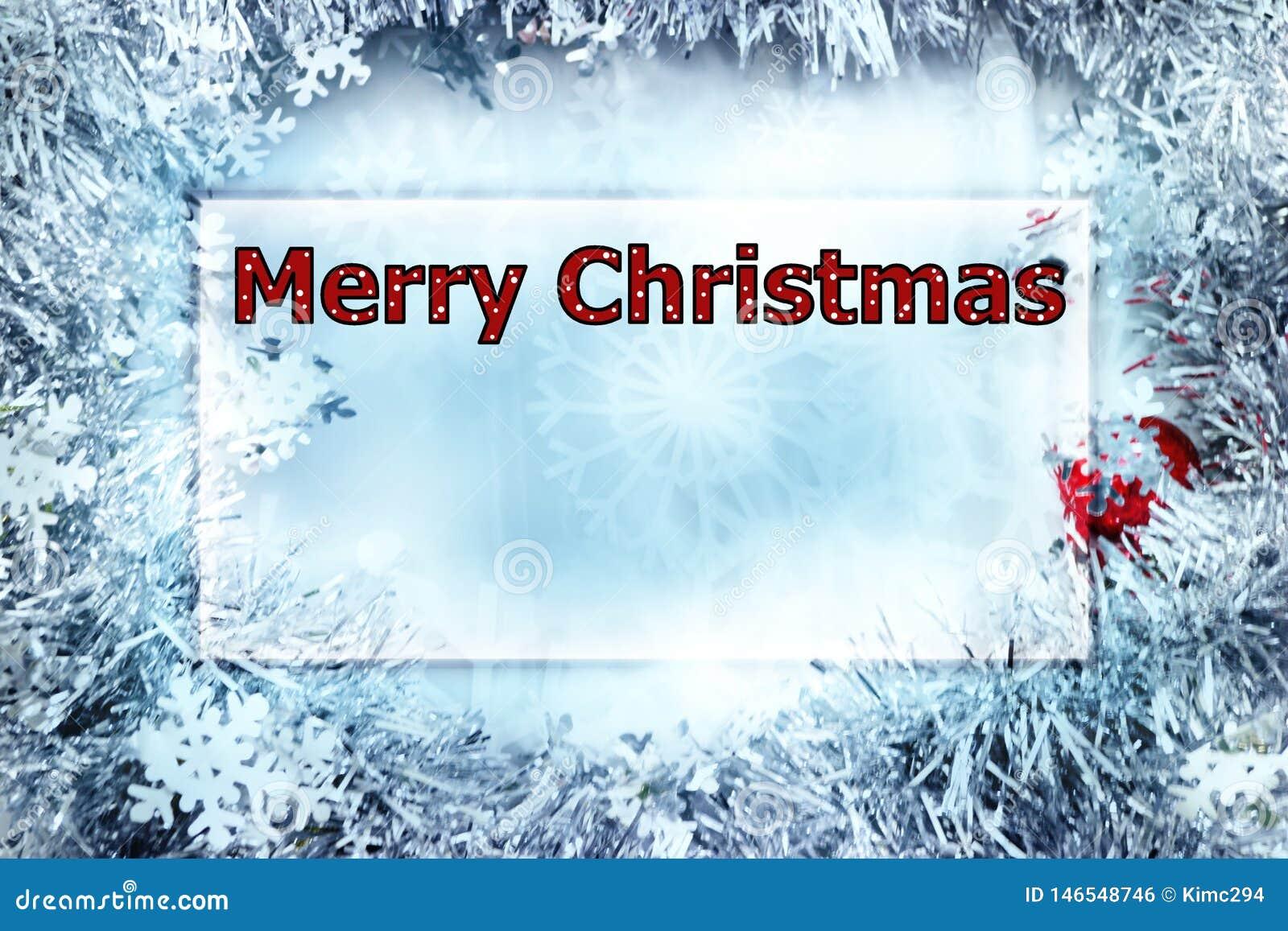De kaart van de Kerstmisgroet met woorden Vrolijke Kerstmis in stipbrieven, rood en wit