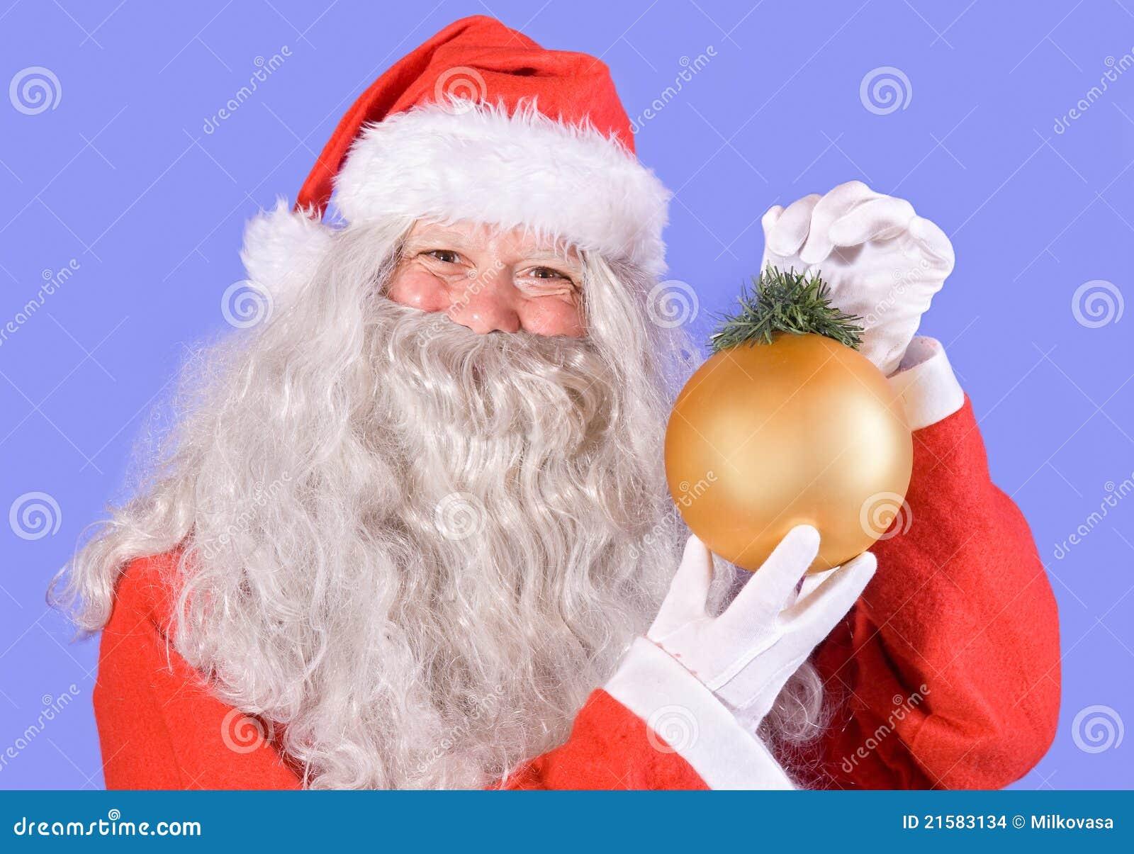 De kerstman die een decoratie van kerstmis houdt stock foto afbeelding 21583134 - Decoratie van een gang ...