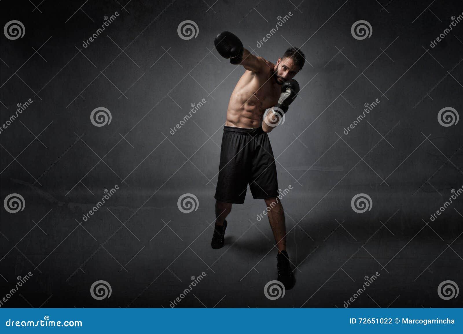 De klap van de bokseraanval
