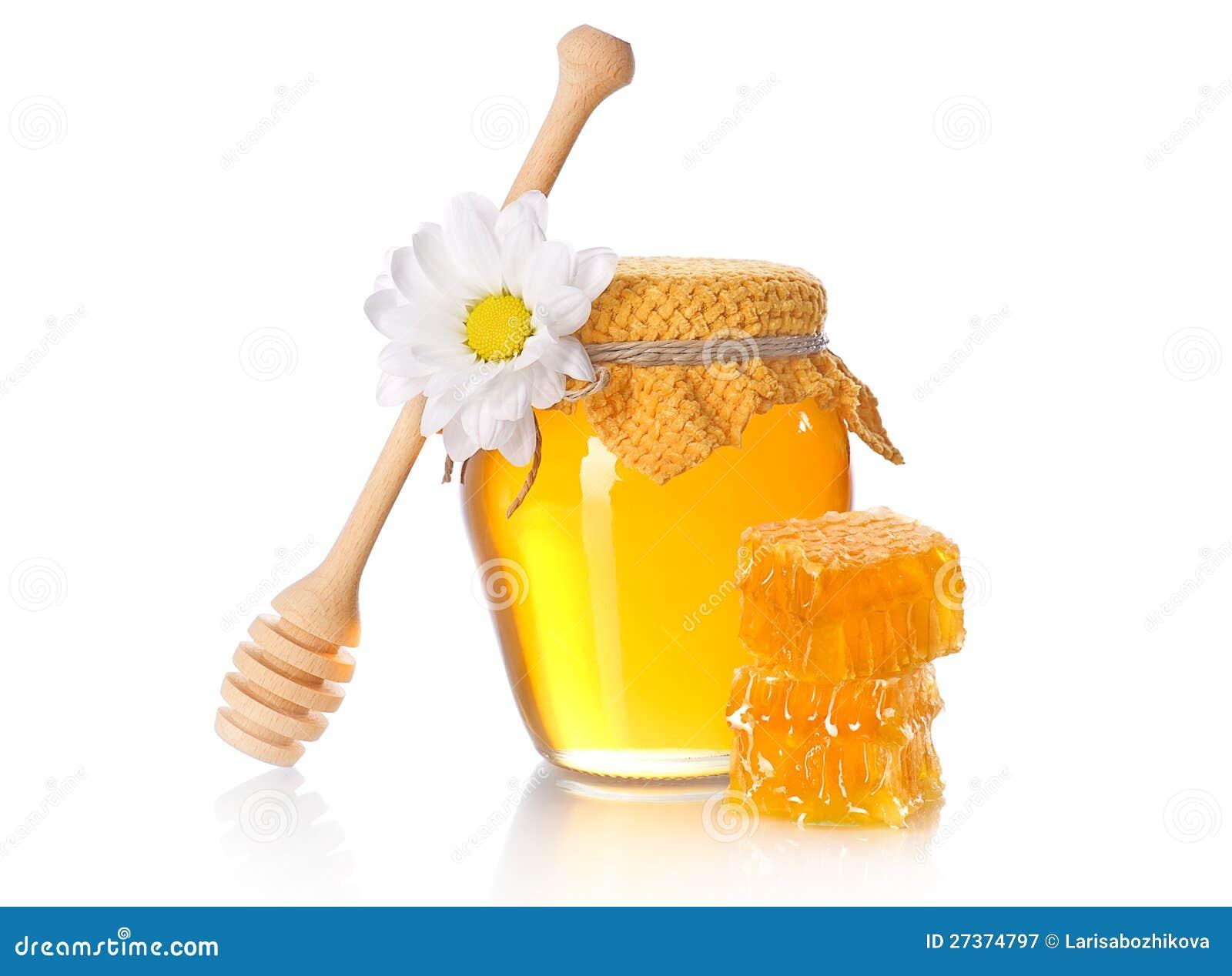 De kruik van de honing met honingsdipper