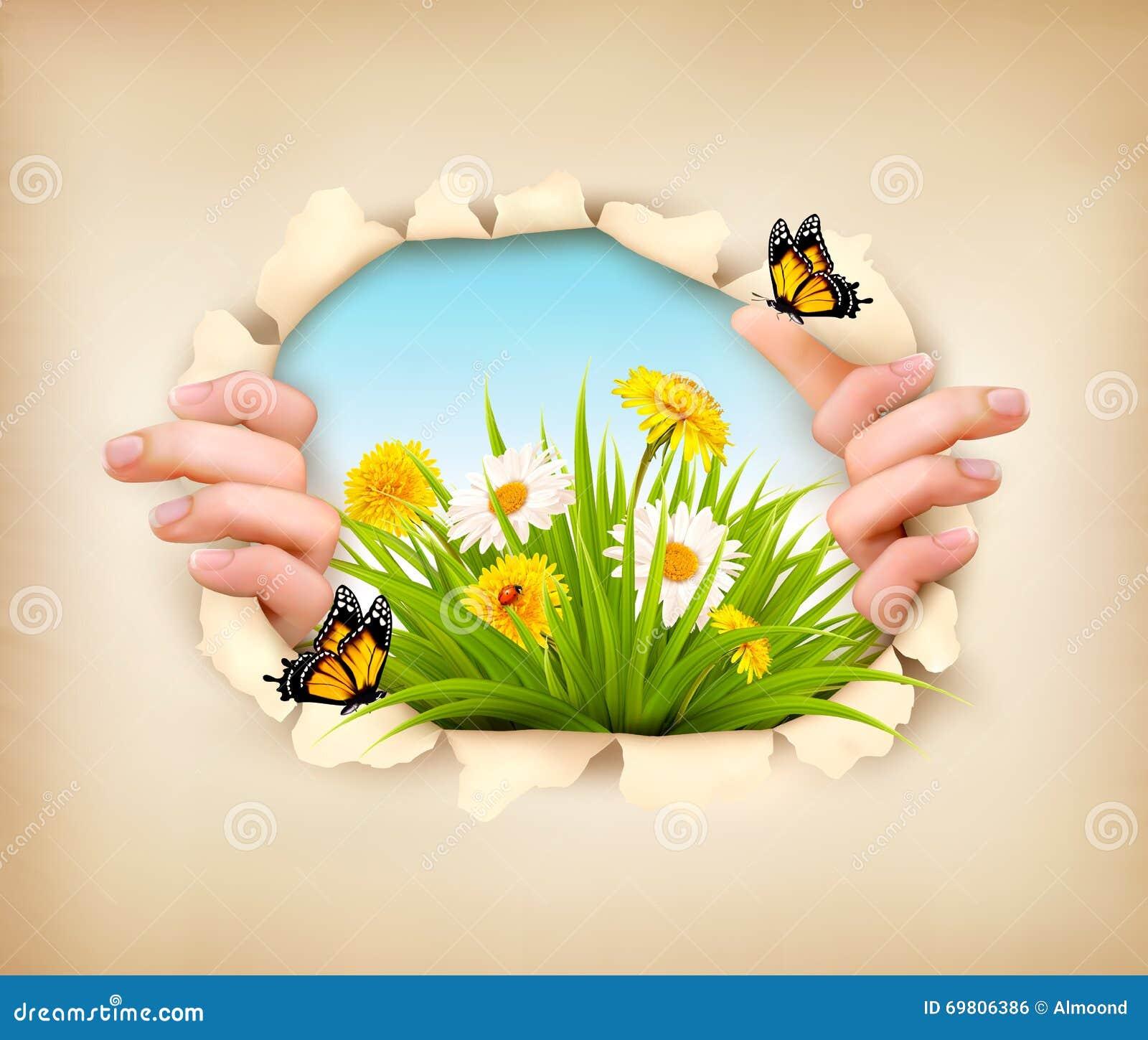 De lenteachtergrond met handen, scheurend document om een landschap te tonen