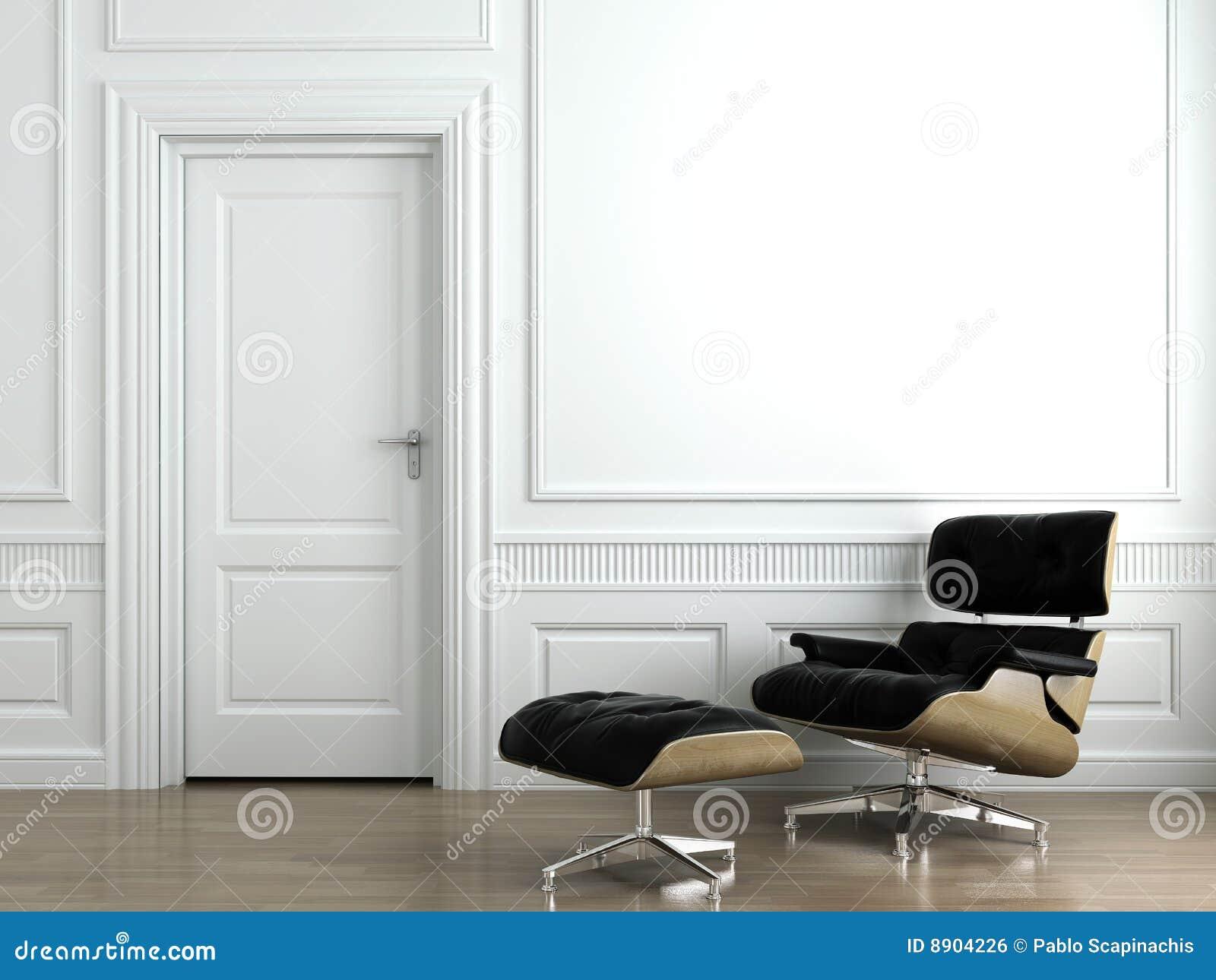 De leunstoel van het leer op witte binnenlandse muur