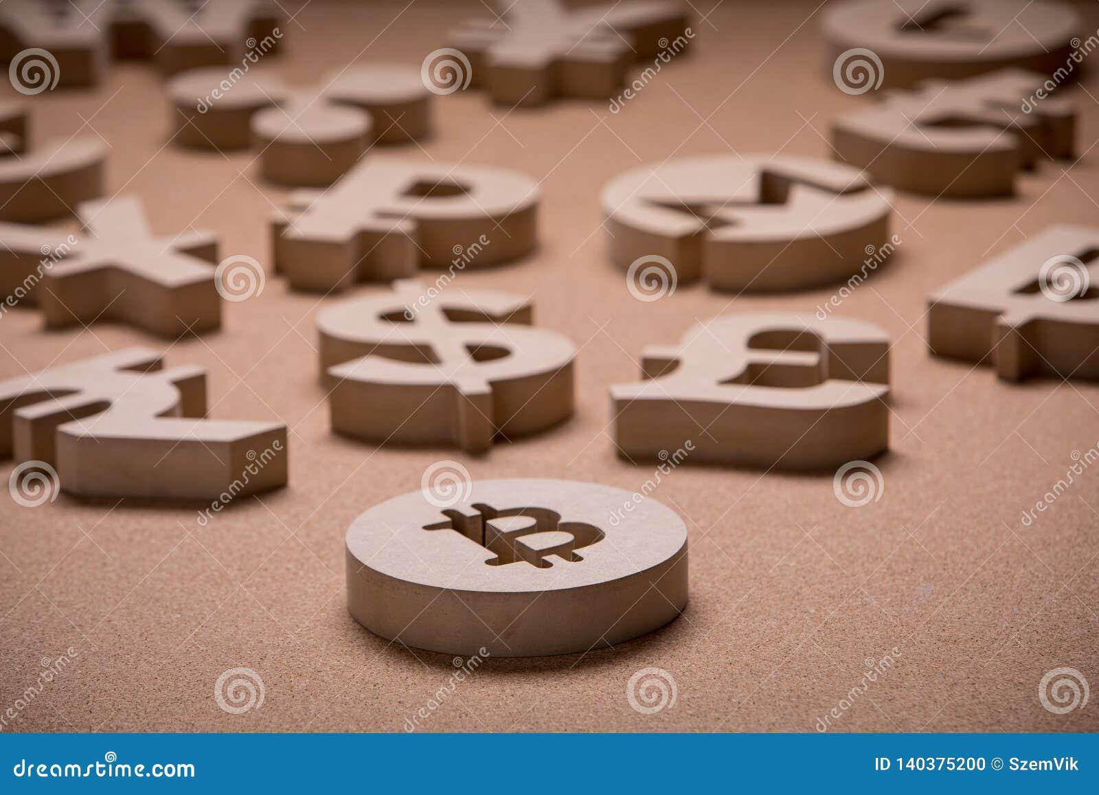 De madera canta o los símbolos de las monedas del mundo en imagen del grupo