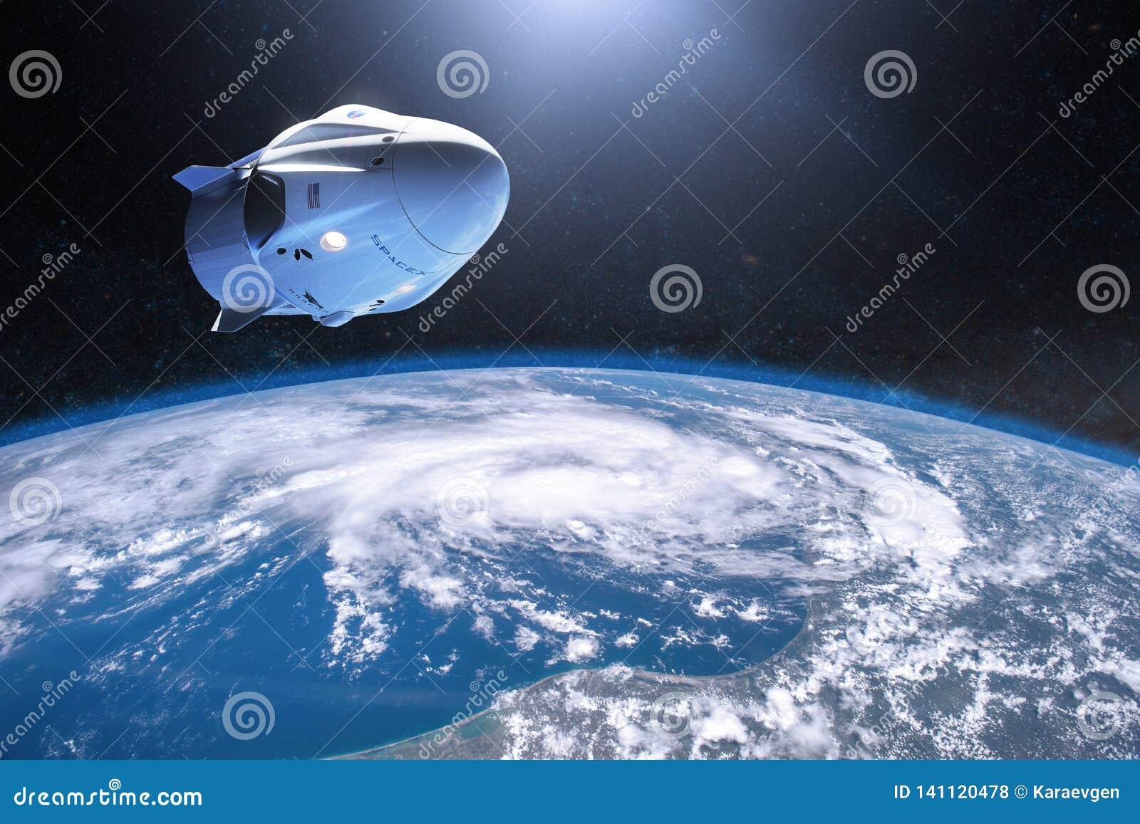 3 de março de 2019: Nave espacial do dragão do grupo de SpaceX na órbita da baixo-terra Elementos desta imagem fornecidos pela NA