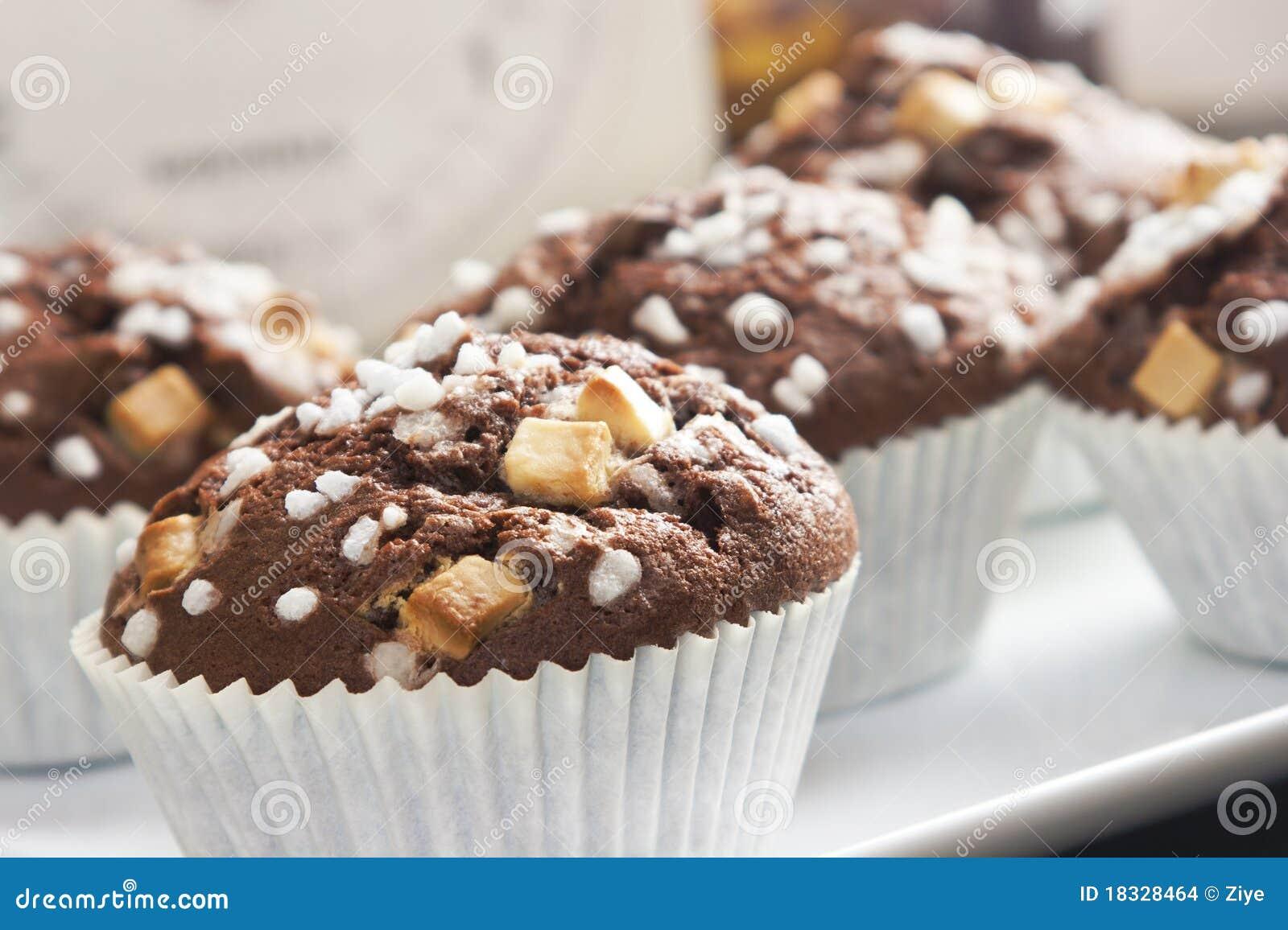 De muffin van de chocolade met decoratie stock for Decoratie chocolade