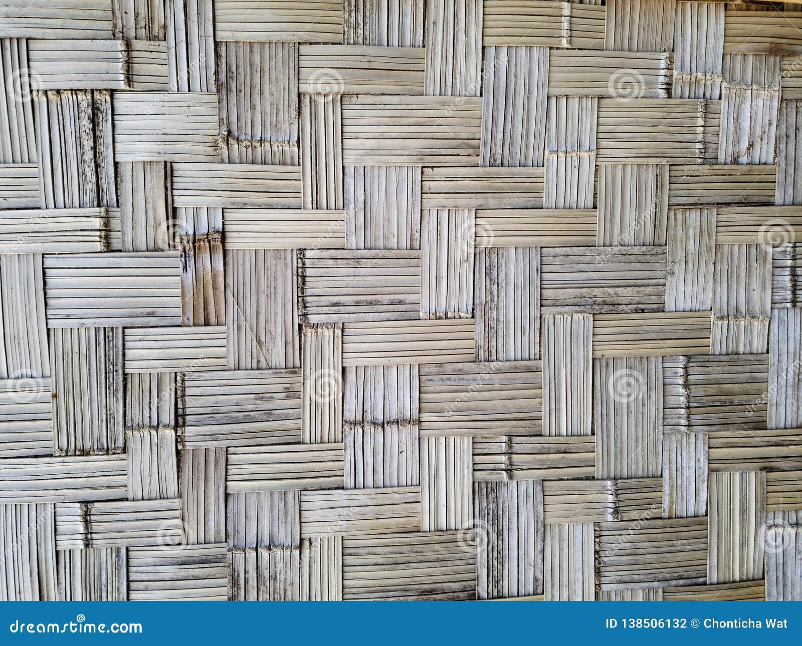 De muur maakte van bamboe abstracte achtergrond