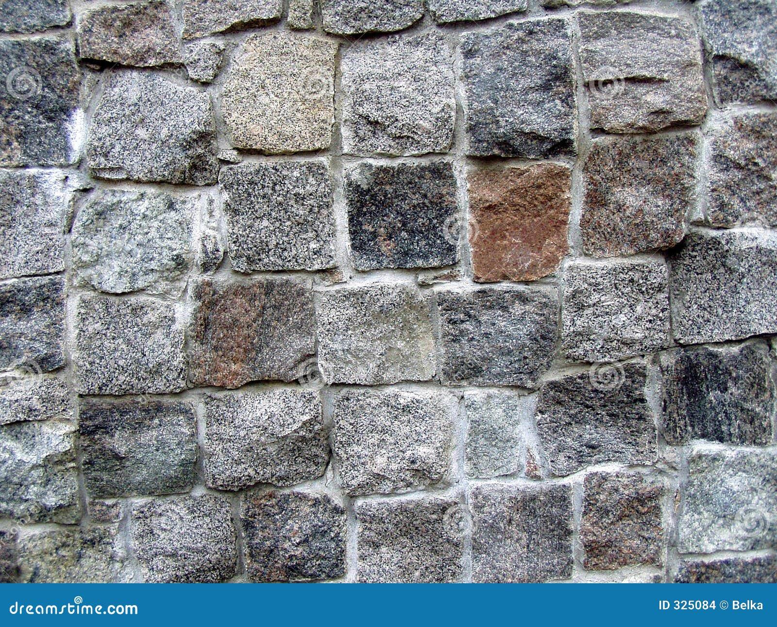 De muur van de steen gedeeltelijk