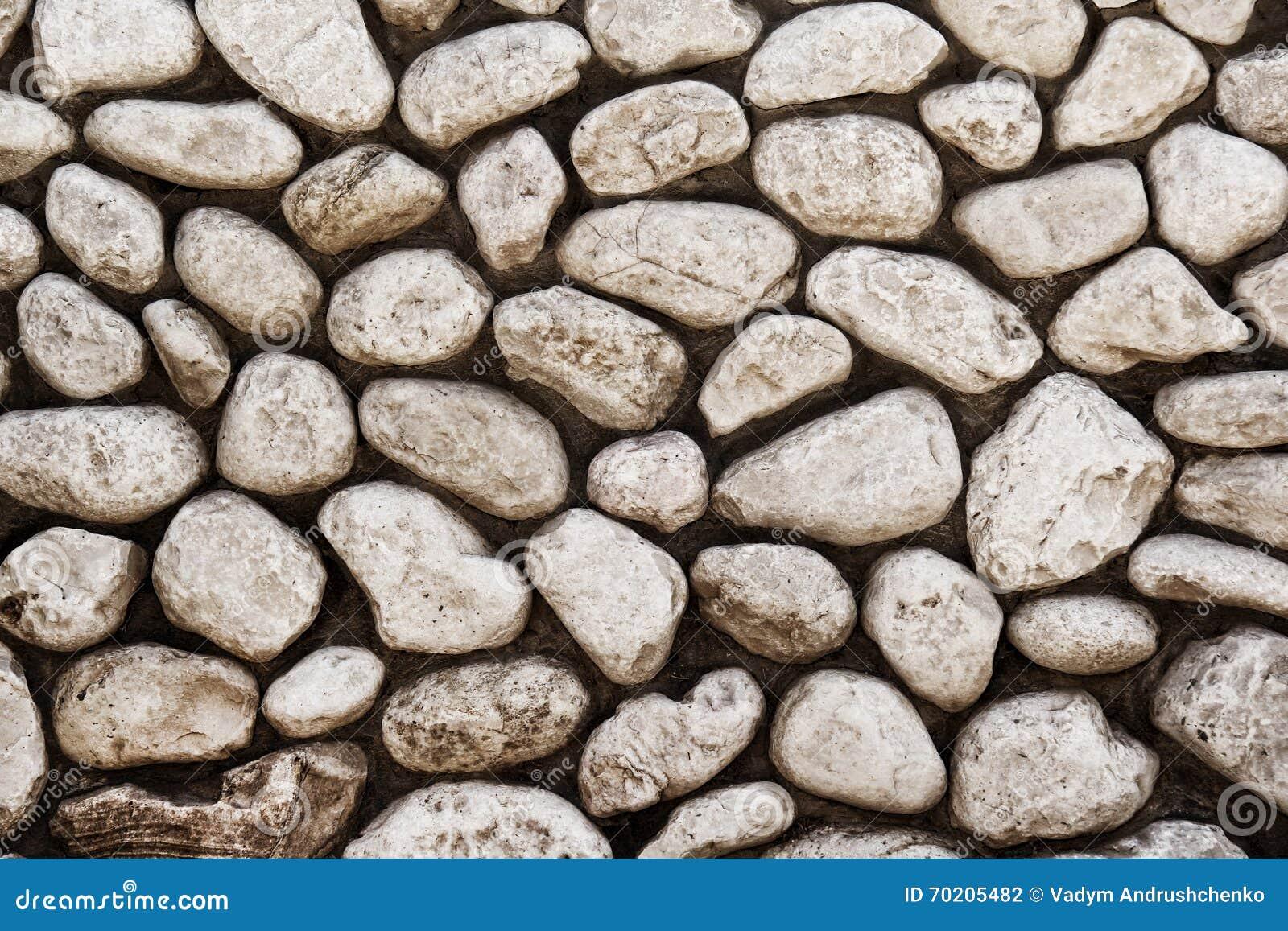 De muurachtergrond van de steen