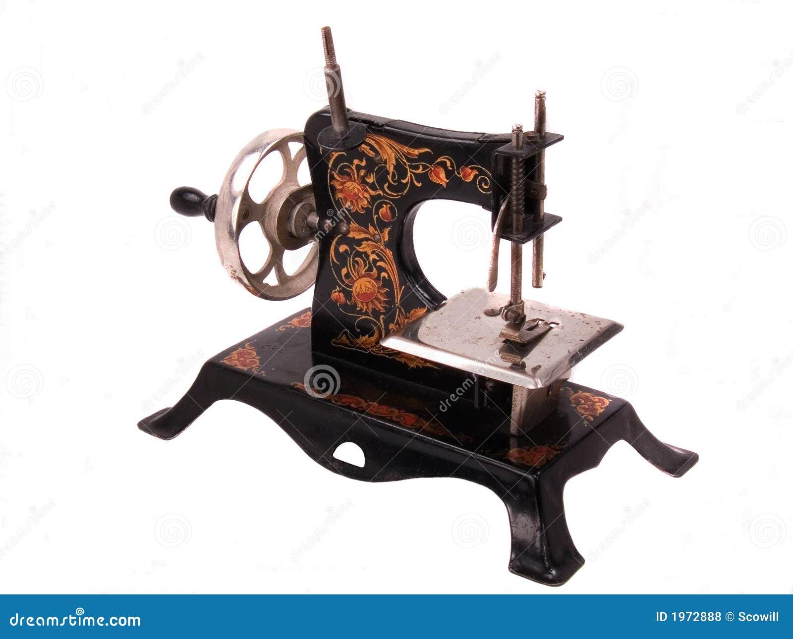 De naaimachine van het stuk speelgoed van het antieke kind for Machine a coudre jouet