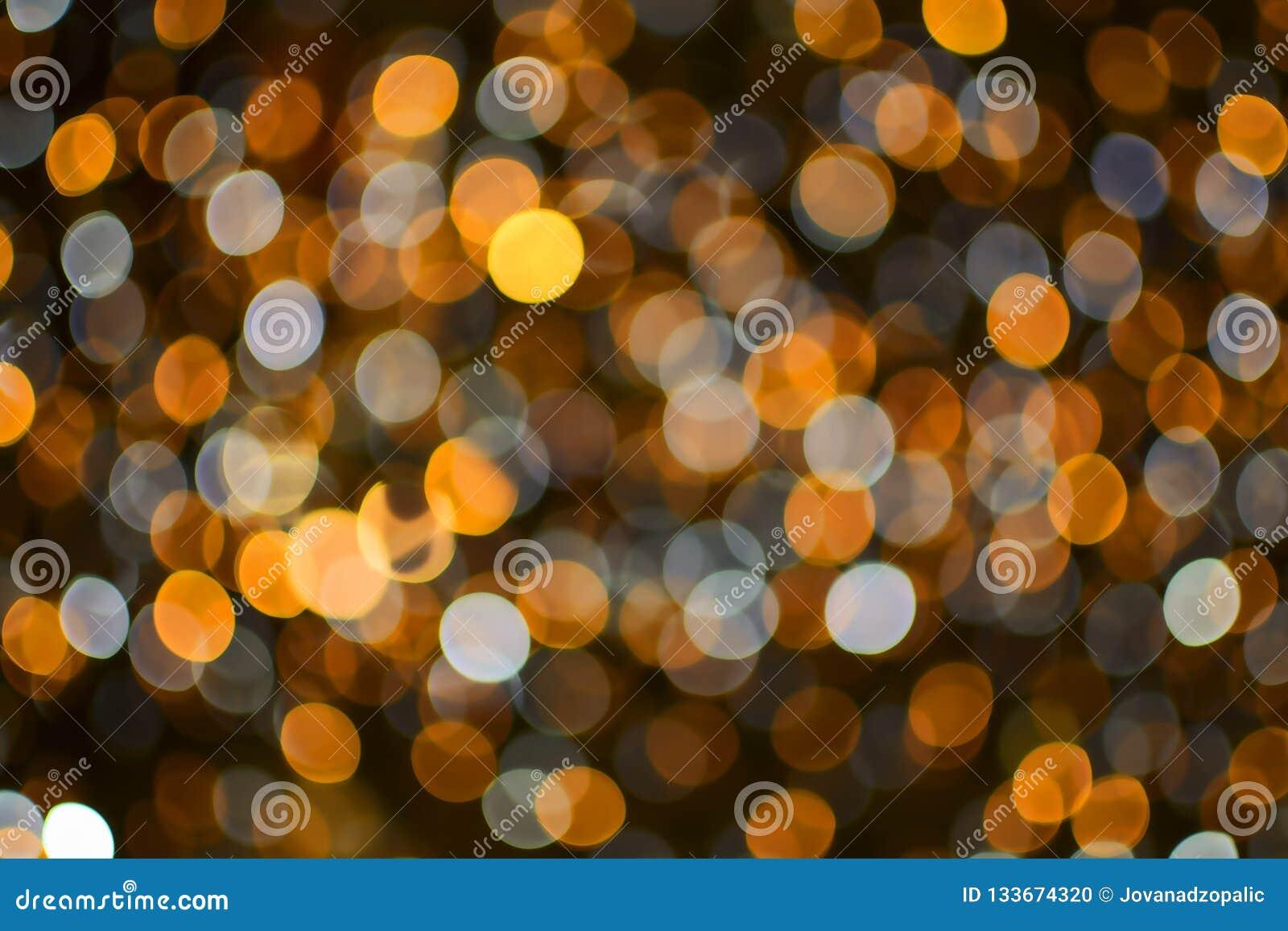 Or de Noël et de nouvelle année et fond blanc de lumières de bokeh