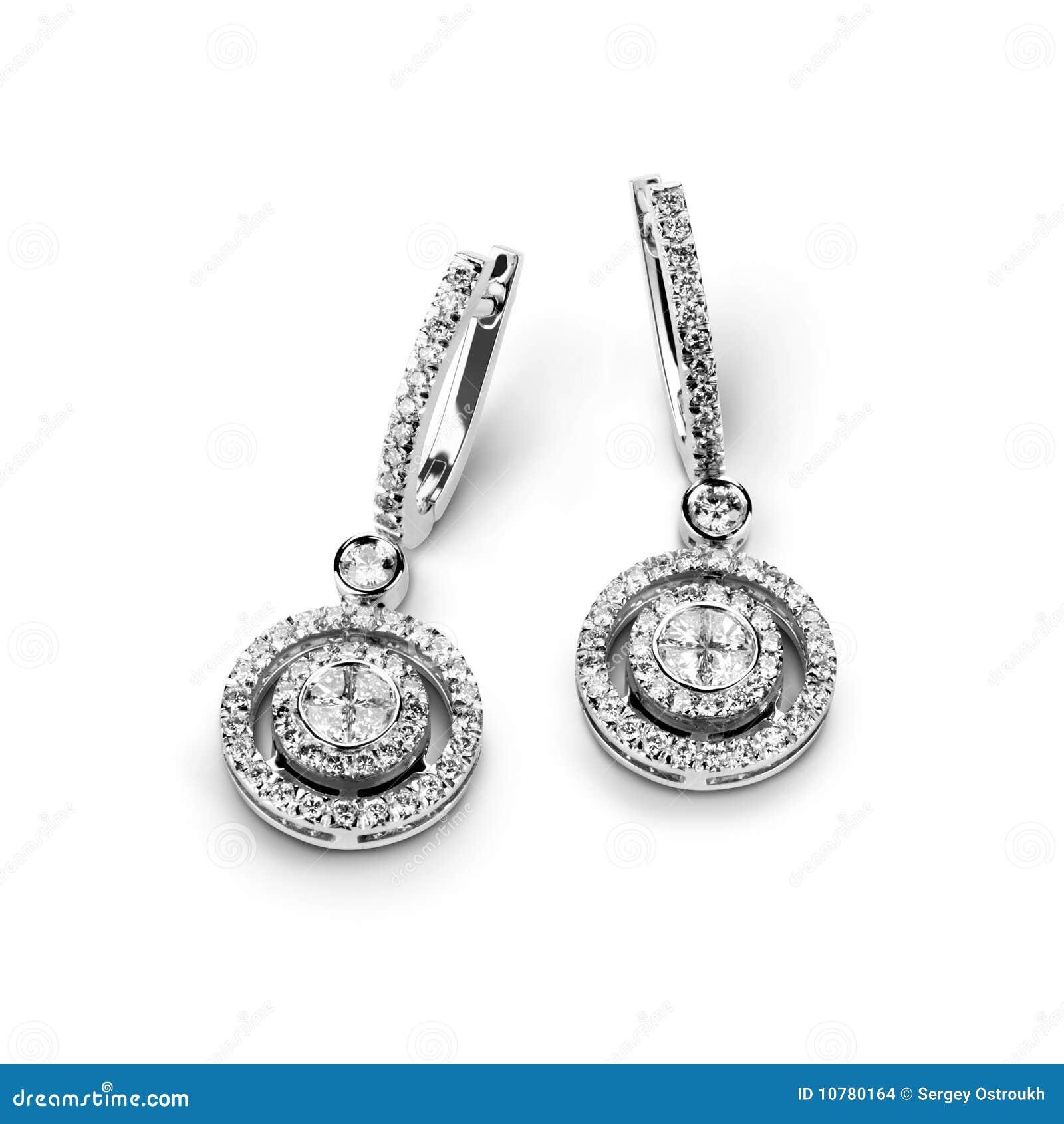 De oorringen van het witgoud met witte diamanten