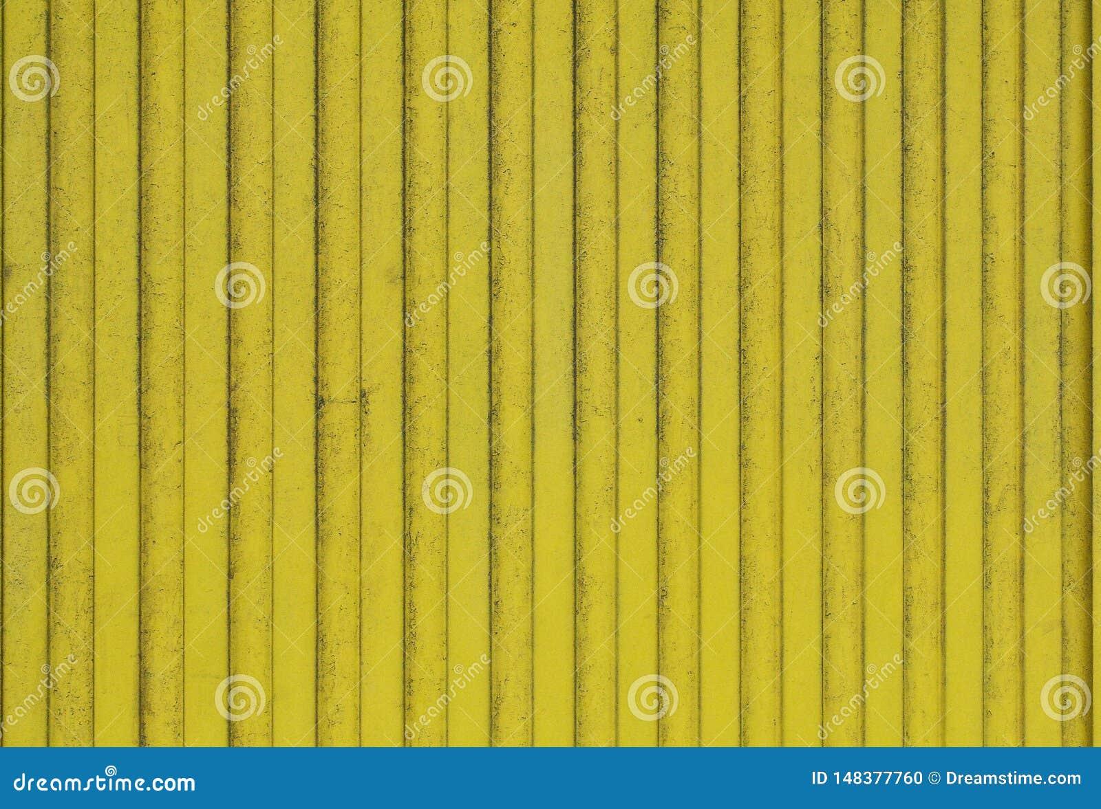 De oude planken van hout schilderden heldere geel