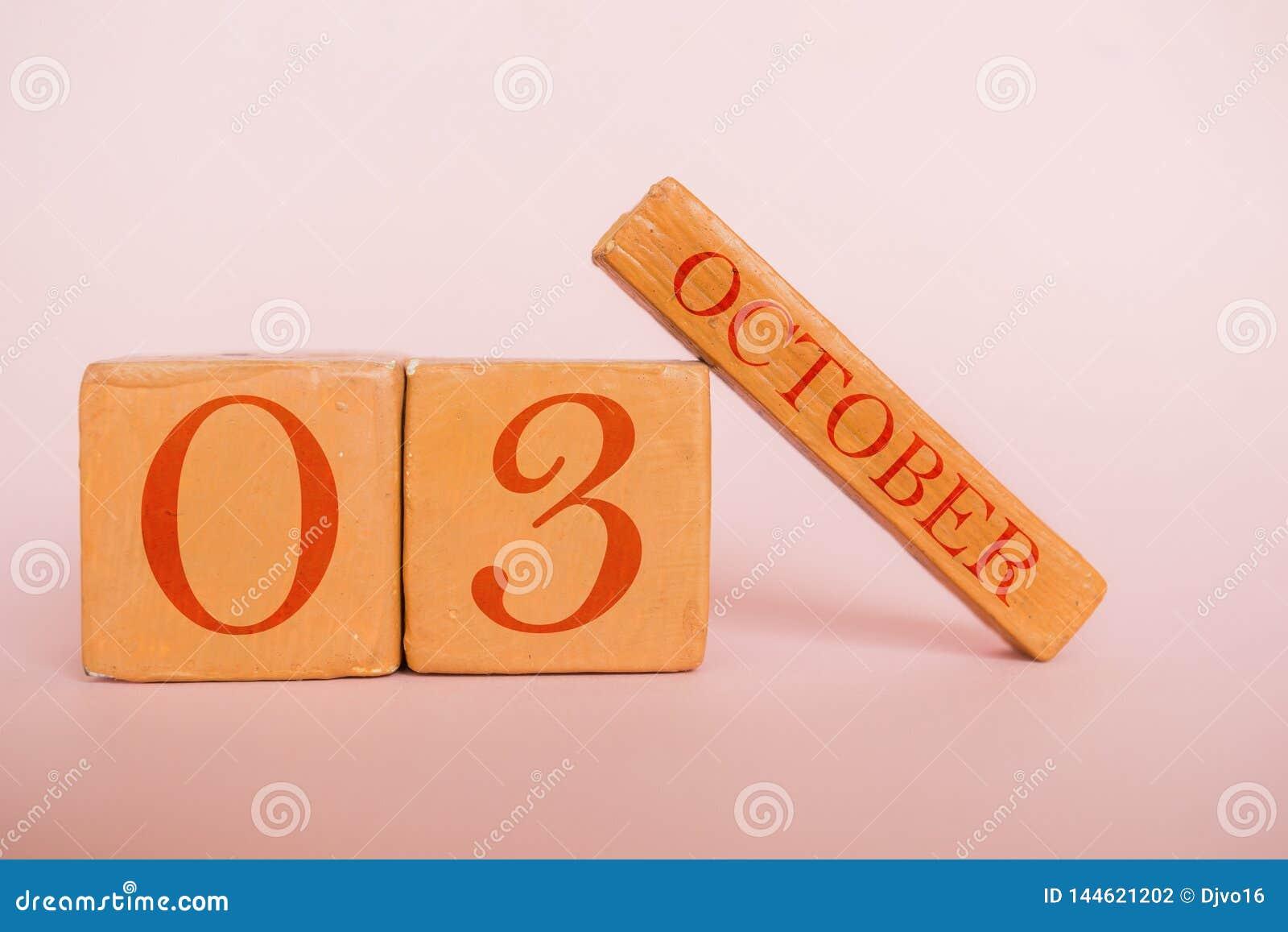 3 de outubro Dia 3 do m?s, calend?rio de madeira feito a m?o no fundo moderno da cor m?s do outono, dia do conceito do ano