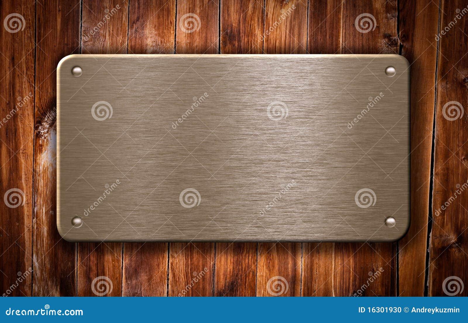 de plaque m tallique en laiton sur le fond en bois photo. Black Bedroom Furniture Sets. Home Design Ideas