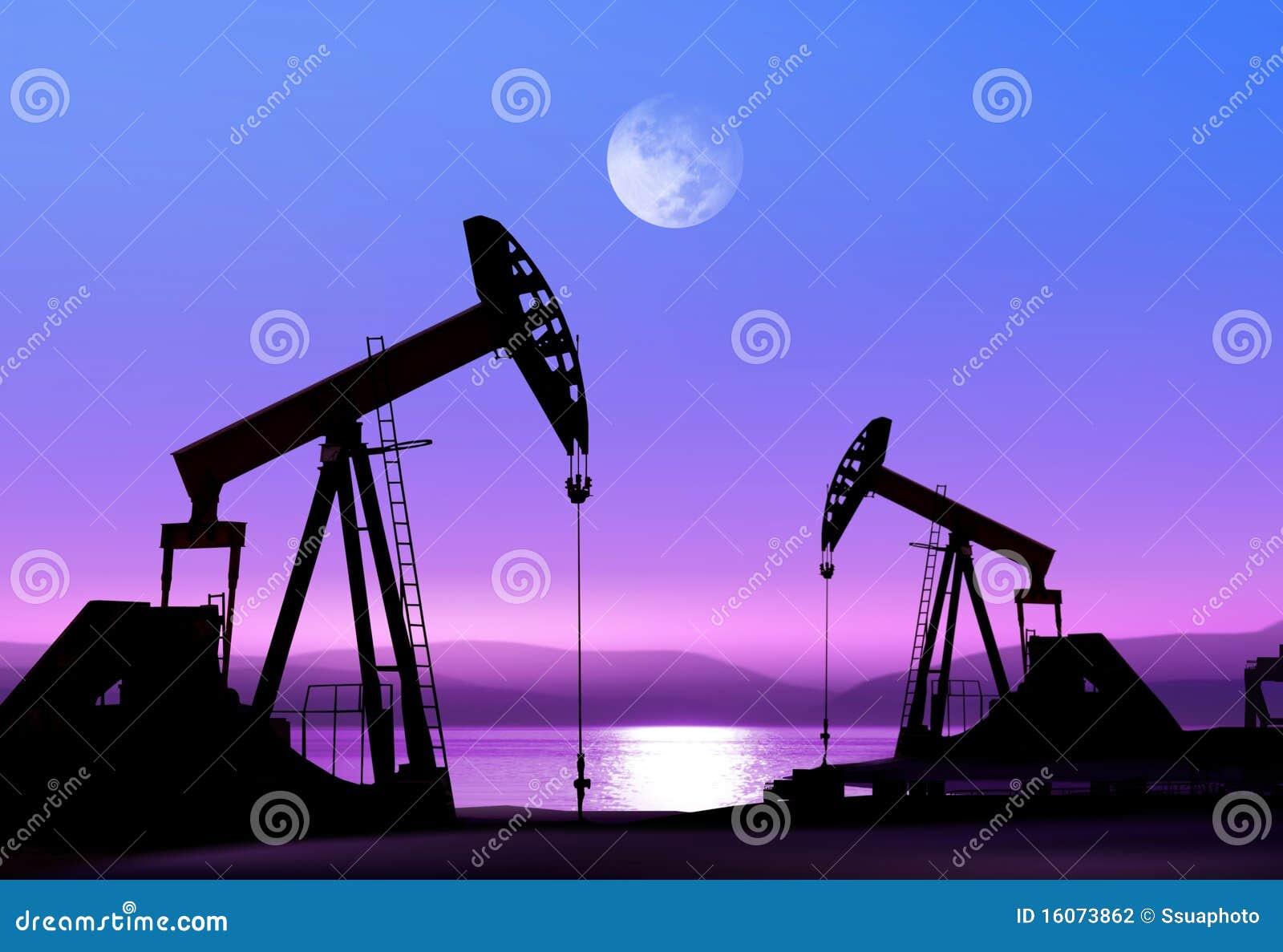 De pompen van de olie bij nacht