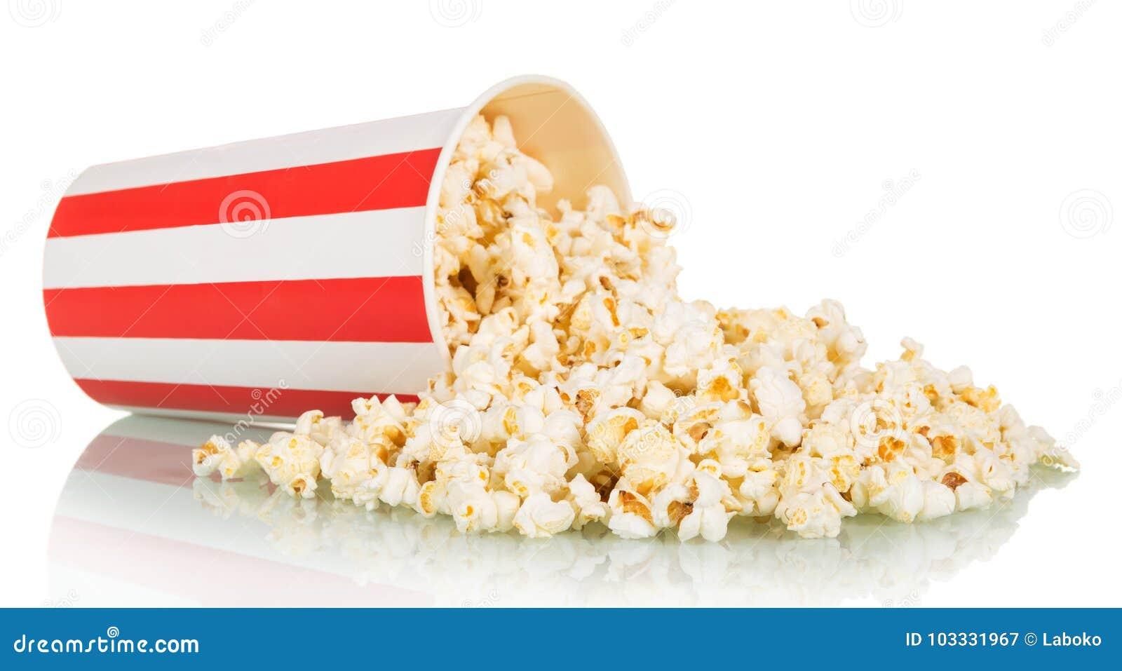 De popcorn werd verspreid van grote gestreepte die doos, op wit wordt geïsoleerd