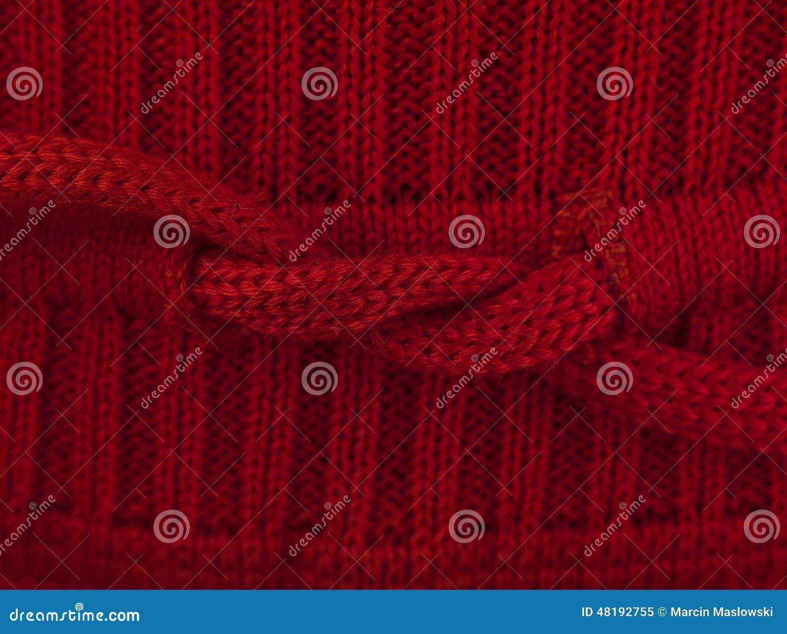 De rode macro van de boogsweater
