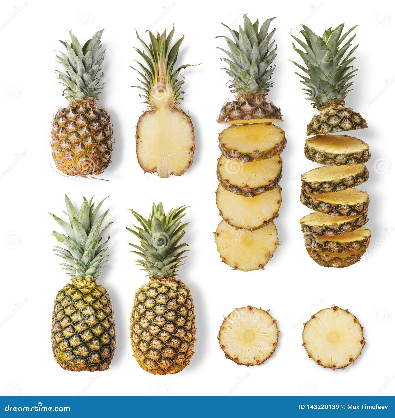De sappige rijpe ananassen van verschillende verscheidenheden zijn geheel en snijden op een witte achtergrond Van hoogste mening