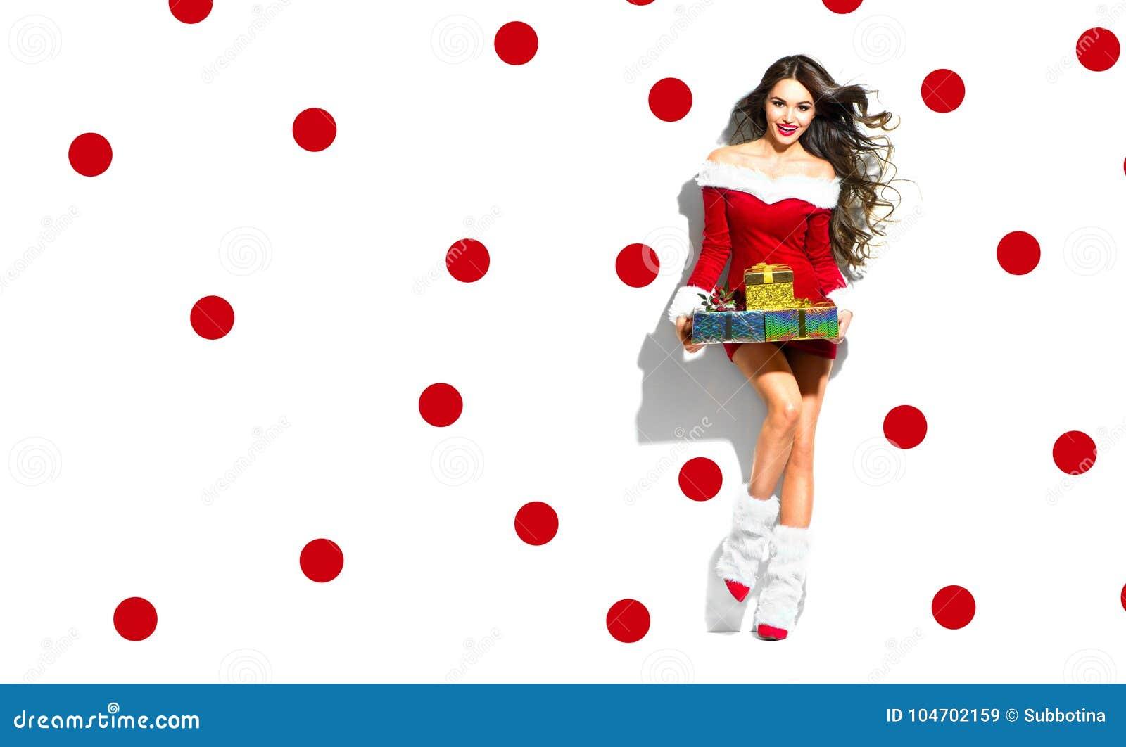 De scène van Kerstmis Sexy santa Schoonheids modelmeisje die rood partijkostuum dragen
