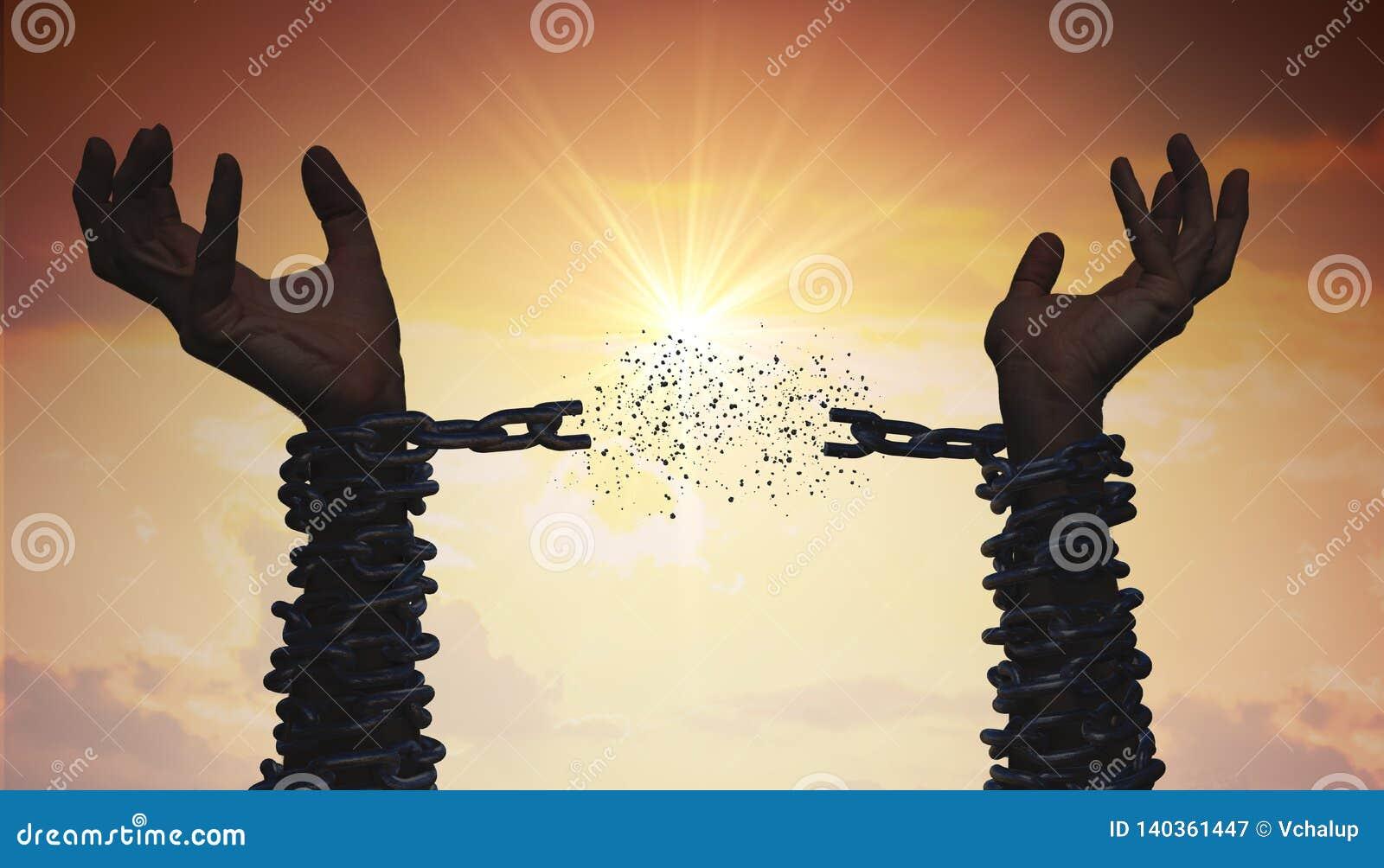 De silhouetten van handen breken ketting Het concept van de vrijheid