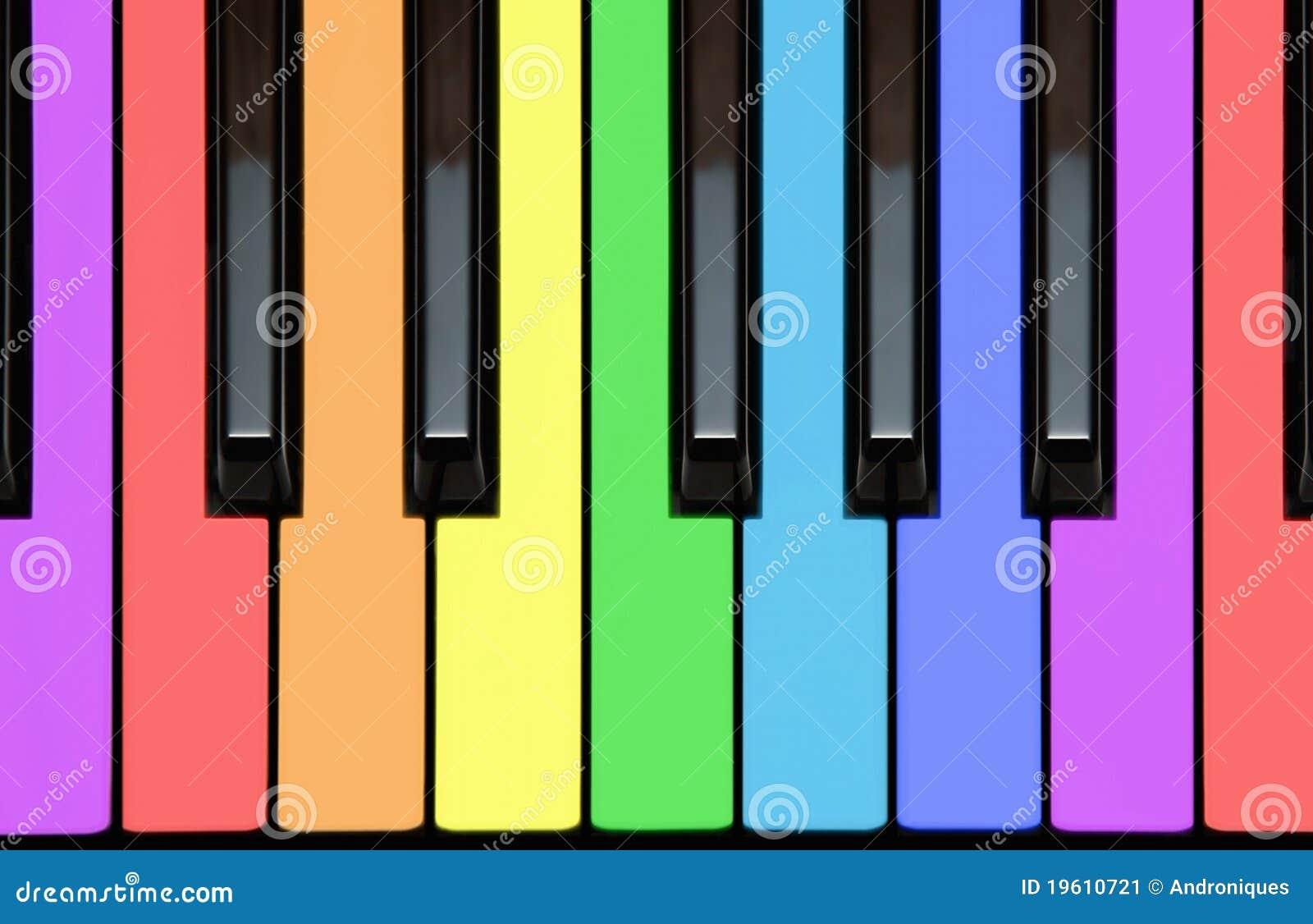 De sleutels van de piano in regenboogkleuren