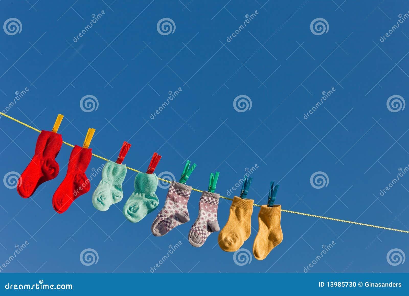 De sokken van de baby op wasserij