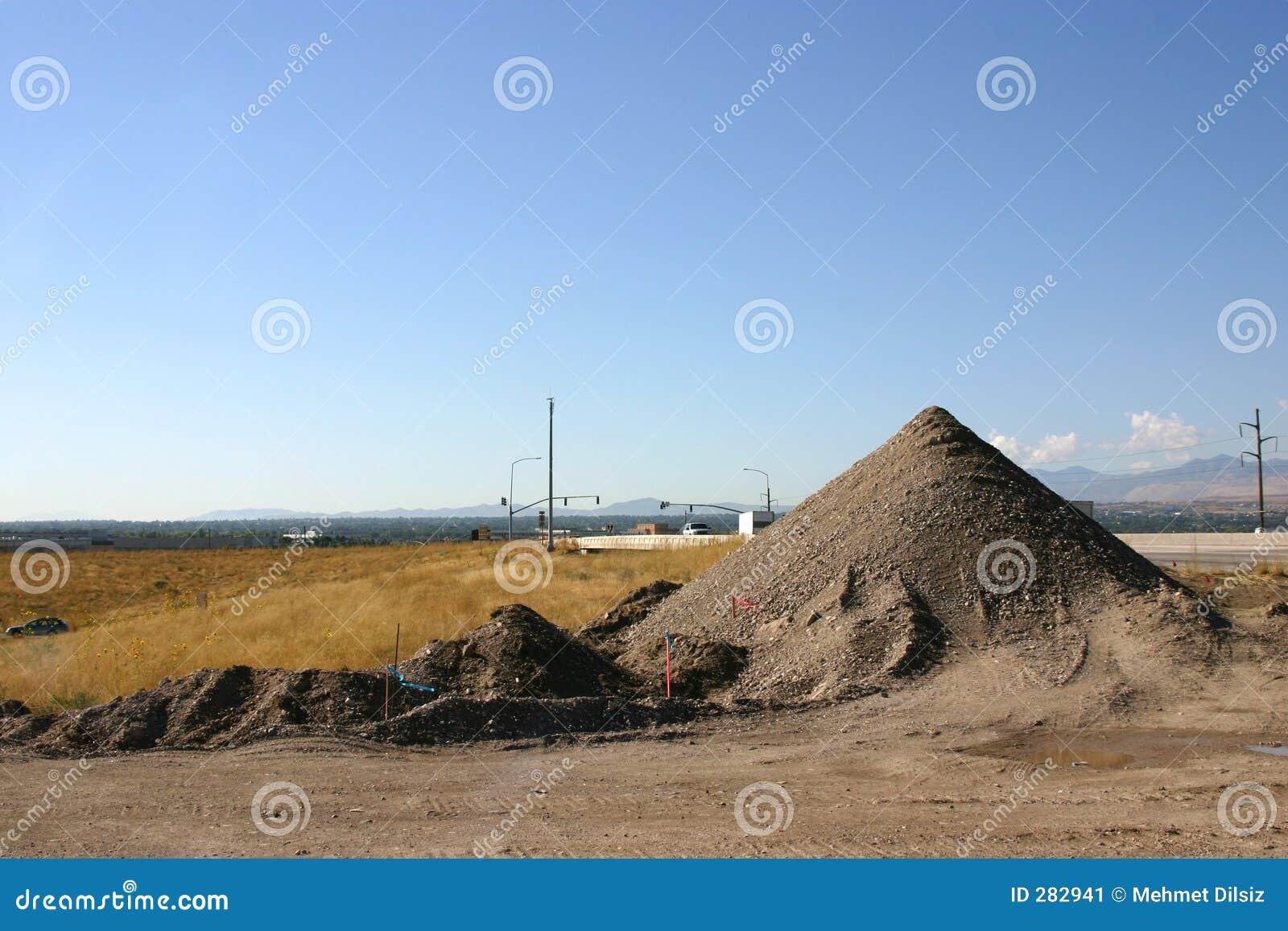 De Stapel van het zand in Bouwwerf