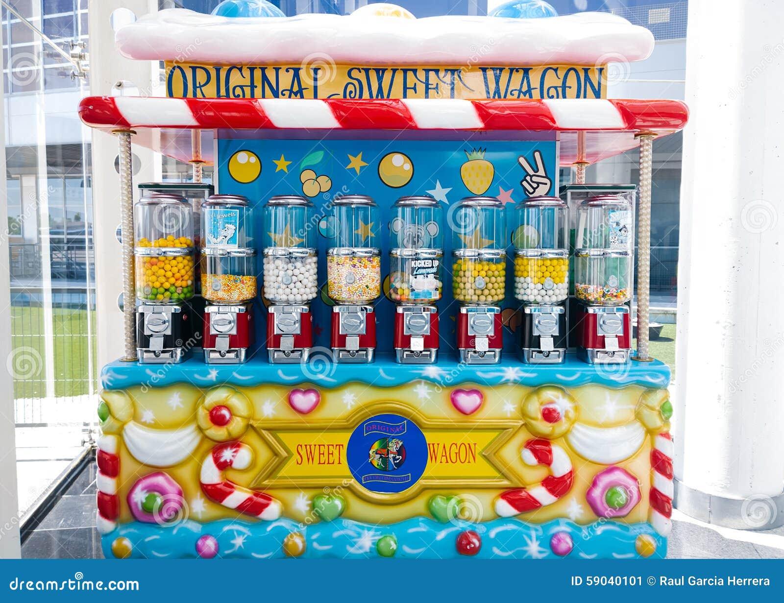 De suikergoedwagen, kleine push-cart stijl behandelde wagen die Suikergoed, chocolade, koekjes, en andere snoepjes verkoopt