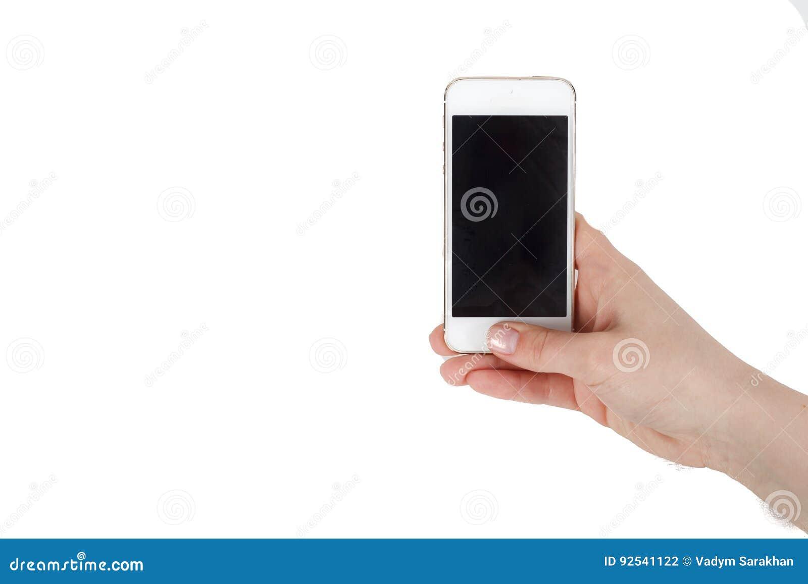 De telefoon is in de hand met het scherm in de camera