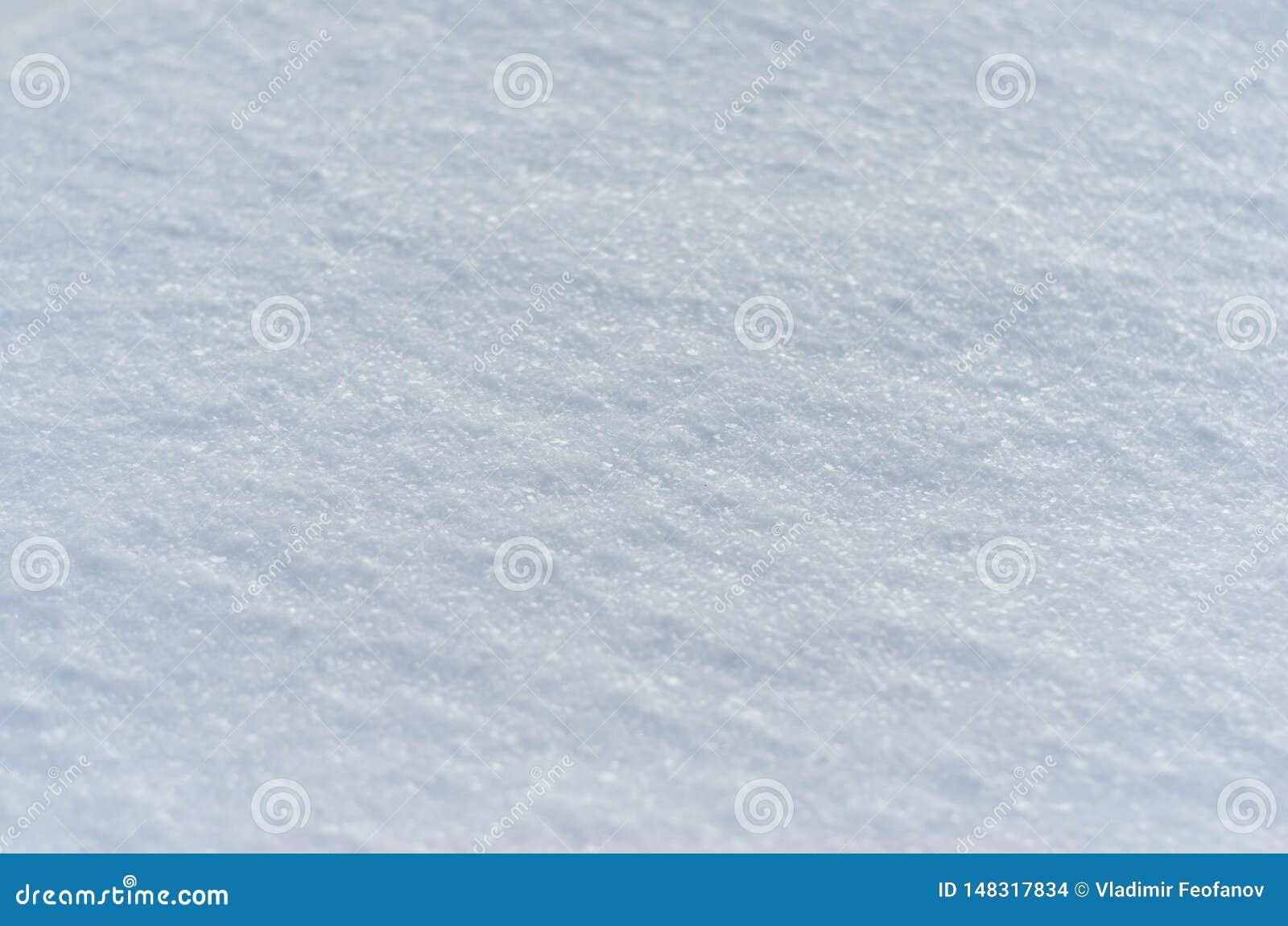 De textuur en de sneeuwachtergrond, sela ective nadruk, koekten sneeuw vlot en stevig wit
