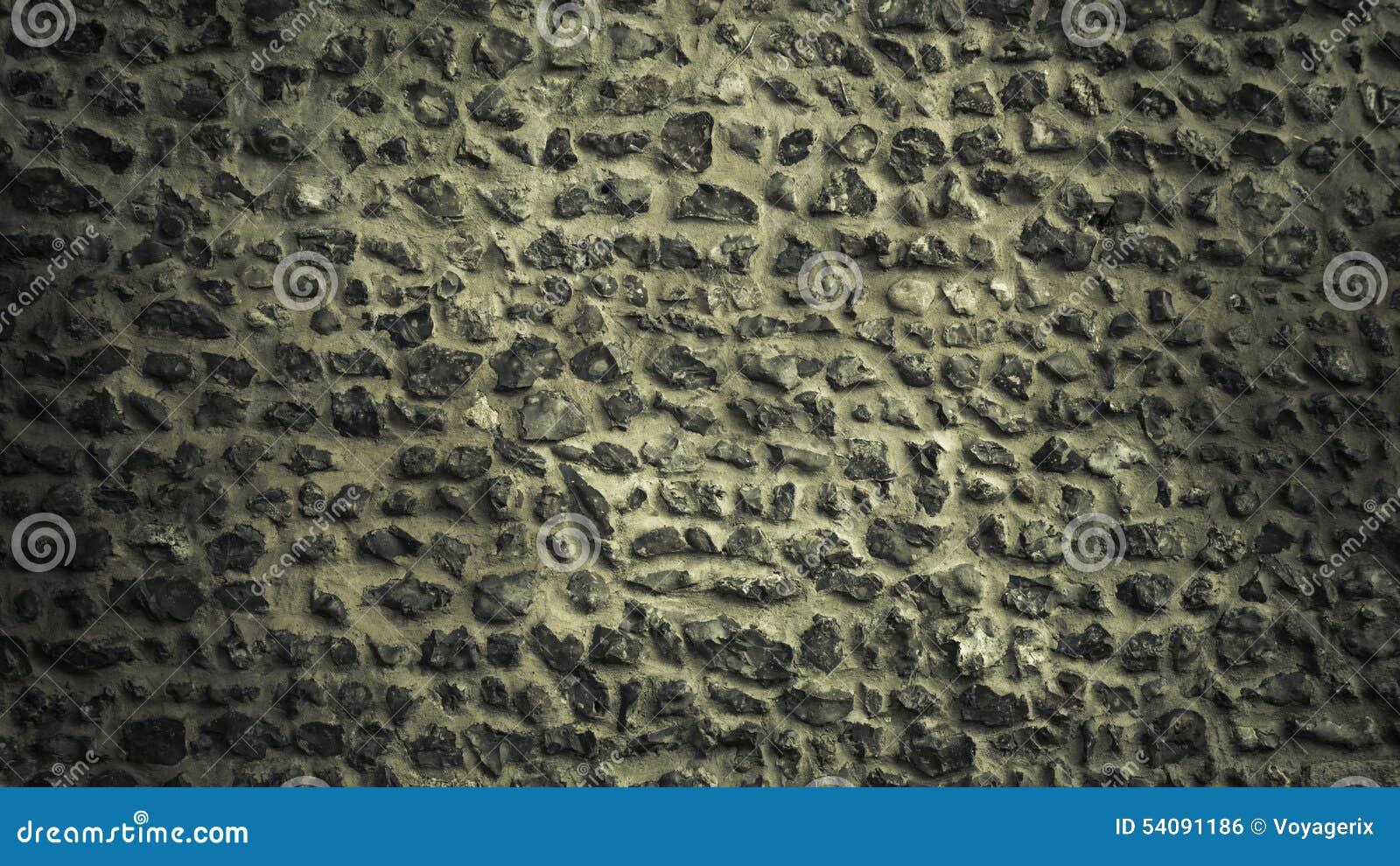 De textuur van de achtergrondsteenmuur